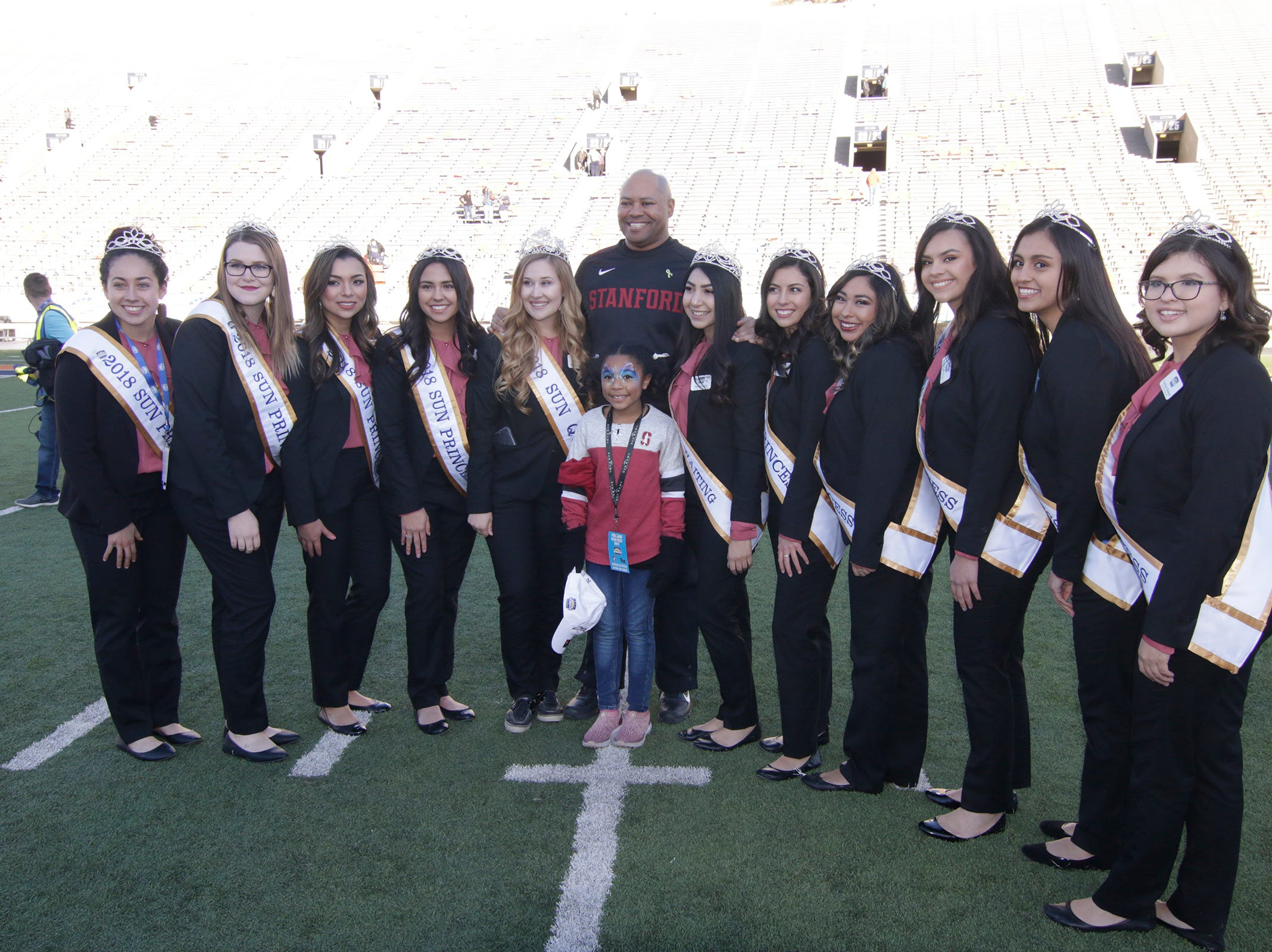 Stanford head coach David Shaw poses for a photo with his daughter and the Sun Bowl court. Shaw led Cardinal team over the Pitt Panthers for a come from behind win 14-13 to take home the championship trophy from  the 85th Hyundai Sun Bowl game.