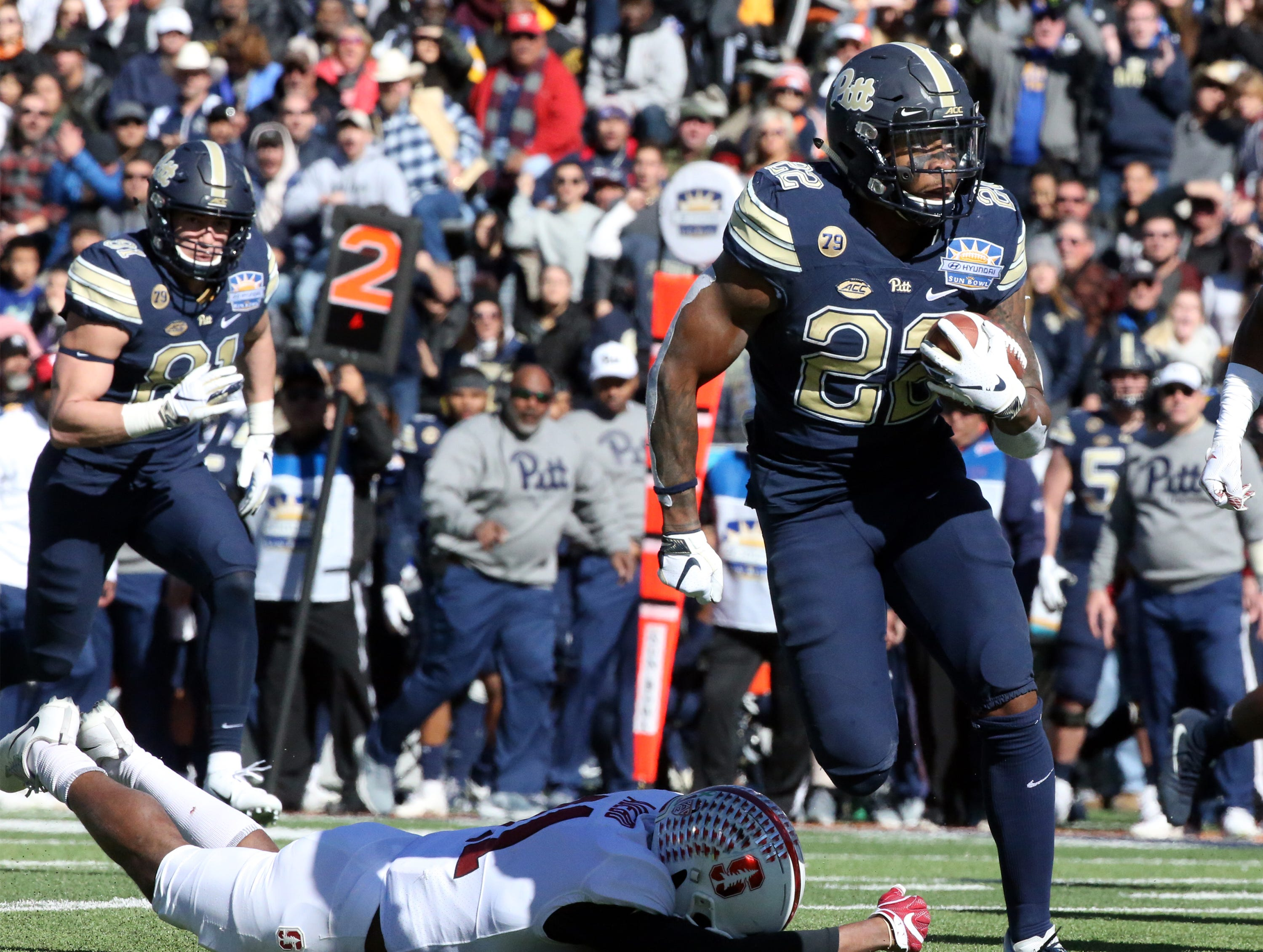 Pitt tail back Darrin Hall, 22, finds running room against Stanford Monday.
