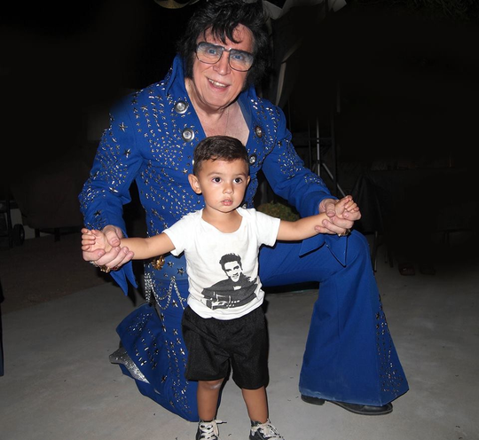 Elvis impersonator Bud Sanders never knows who will be an Elvis fan, such as this youngster at one of his shows.