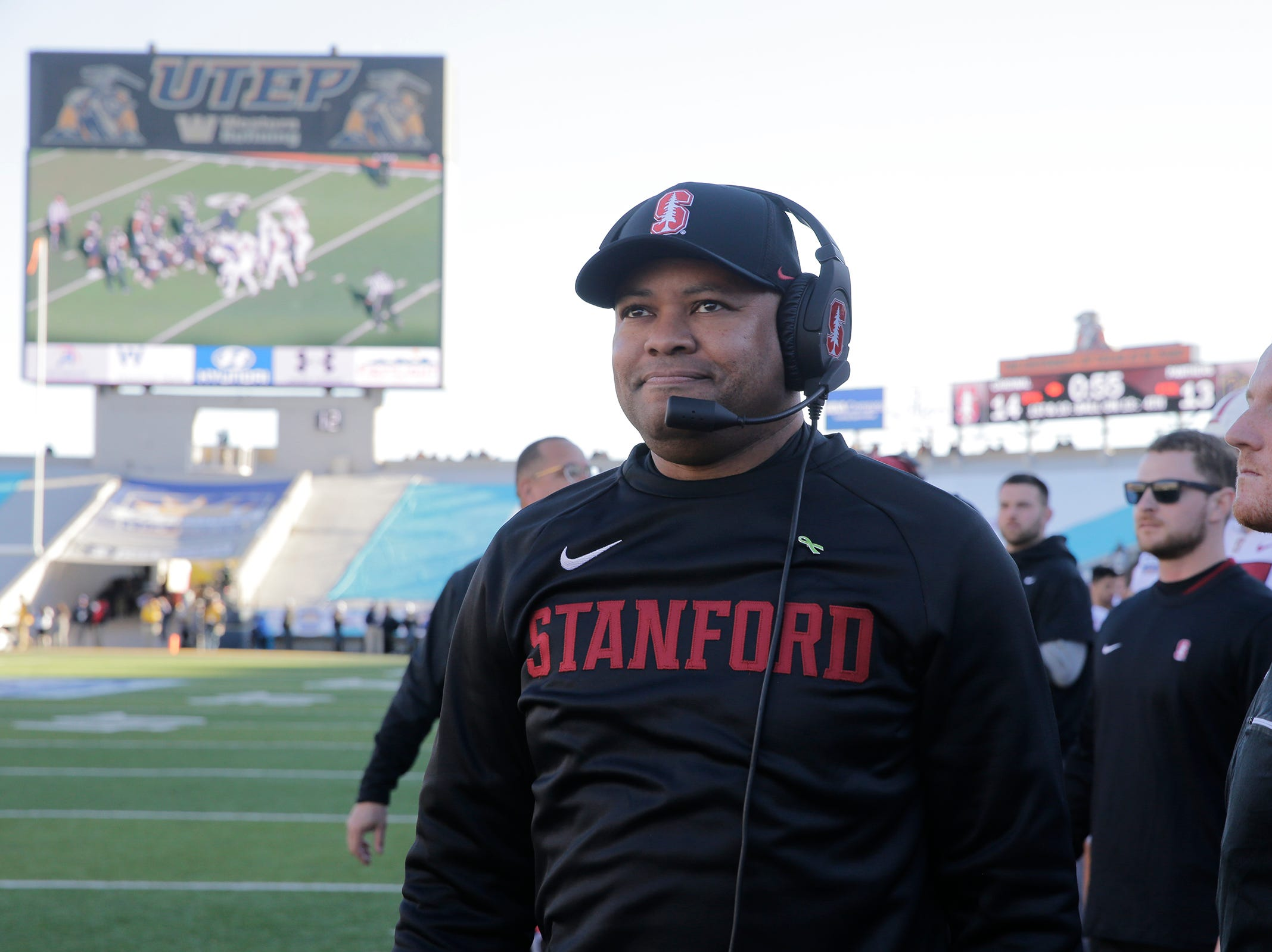 Stanford head coach David Shaw looks up to the game clock as the final seconds click off and his Cardinal team takes home the 85th Hyundai Sun Bowl Championship tropy after a 14-13 win.