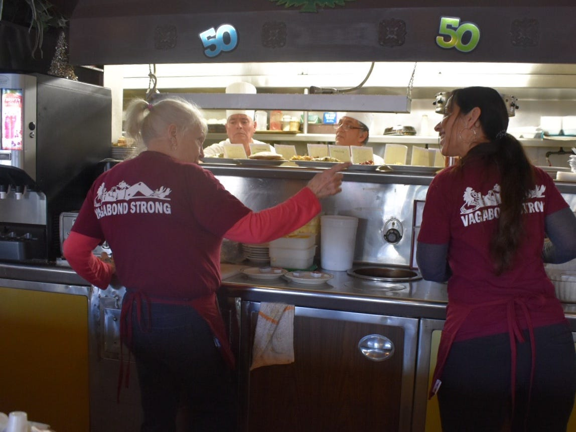 Servers wear Vagabond Strong T-shirts. The landmark restaurant closes Tuesday though the property owner says it will reopen.