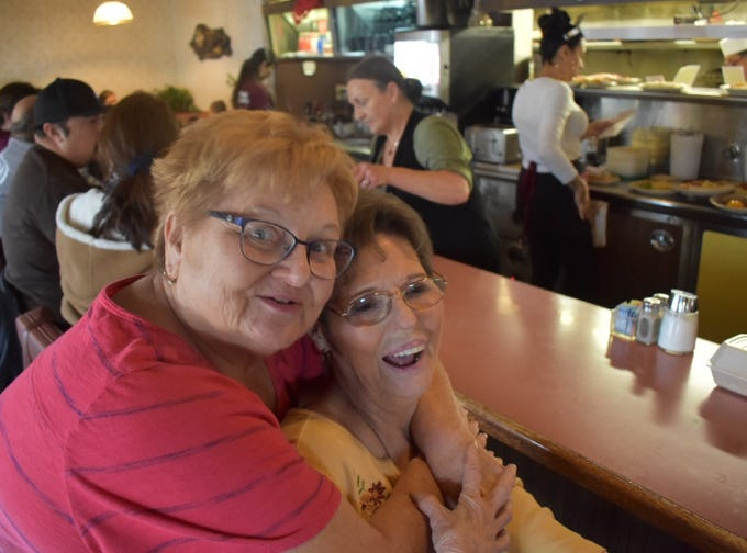 Ida Blackman of Fillmore, left, hugs Vagabond Vagabond Restaurant owner Jolene McBee. The 52-year-old restaurant closes at 9 p.m. Tuesday though the site's landlord says it will reopen after remodeling.
