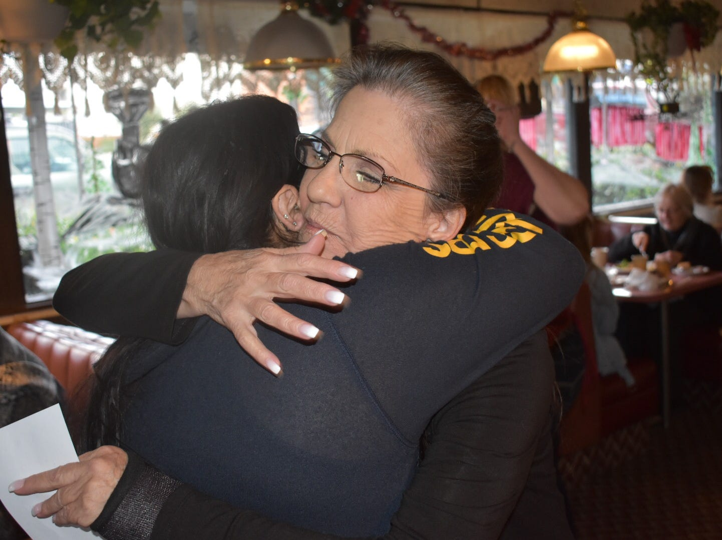 Vagabond Restaurant employee Chris Frank, right, hugs customer Blanca Garcia on Monday. The 52-year-old restaurant closes Tuesday though its landlord says it will reopen.