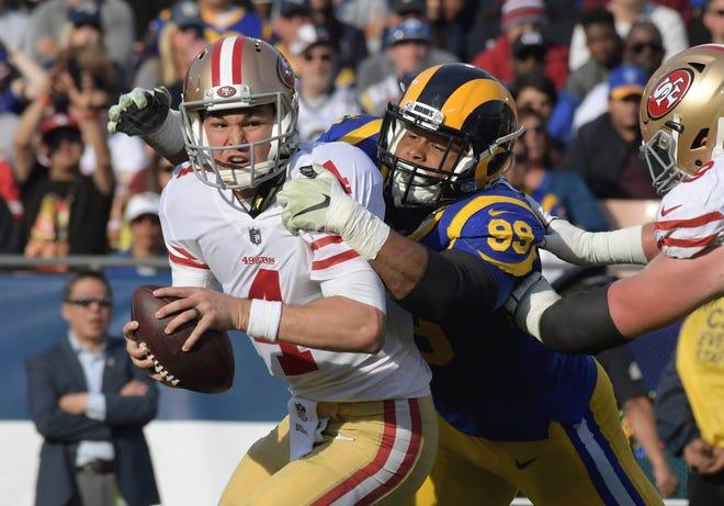 Defensive tackle Aaron Donald sacks 49ers quarterback Nick Mullens during the Rams' regular-season finale Sunday.