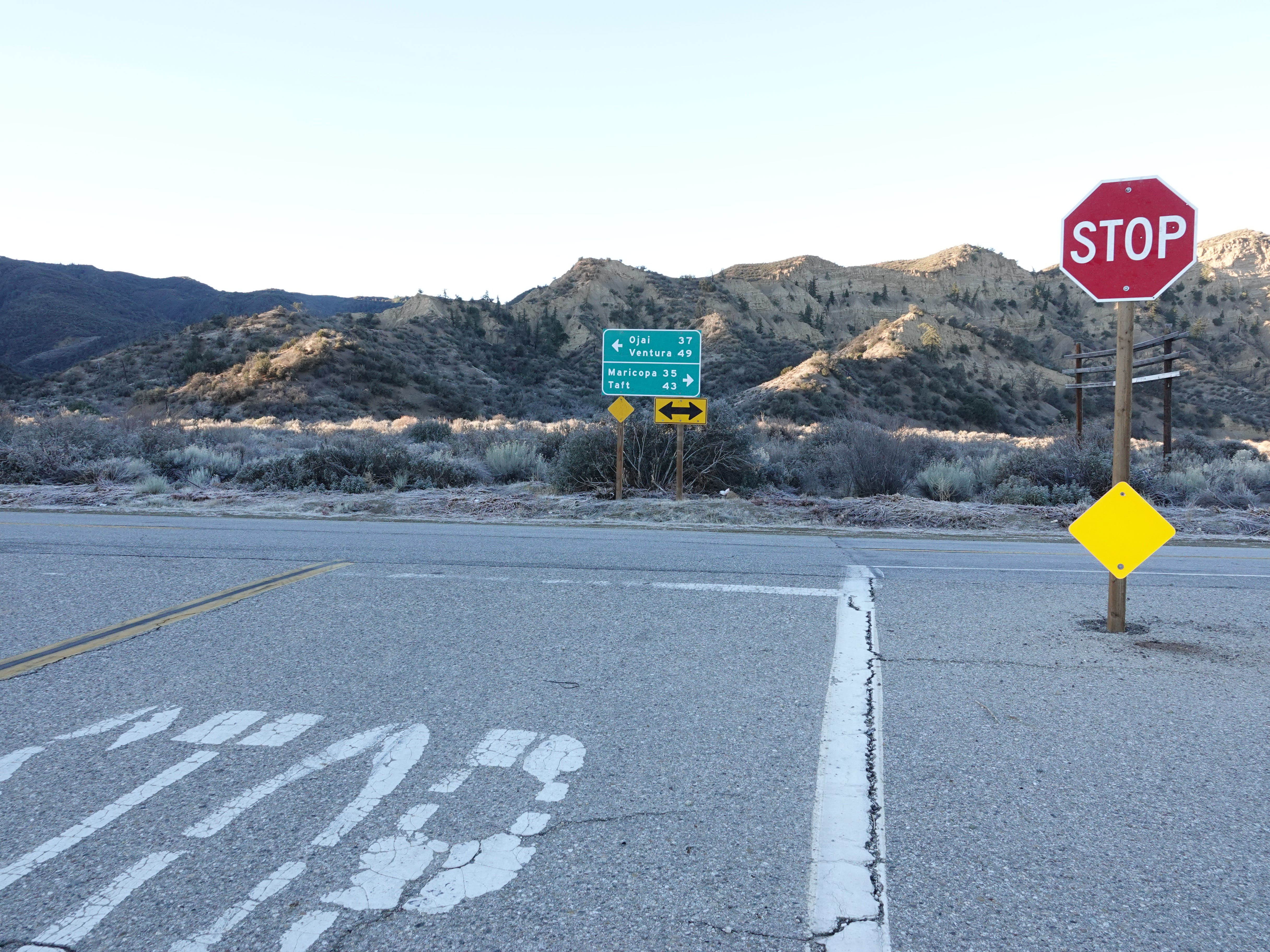 From Lockwood Valley Road at the junction with Highway 33, a green sign directs motorists toward Ojai or Taft. The stop sign is about 18 miles from the Ventura County sheriff's Lockwood Valley substation, where two deputies patrol 610 square miles.