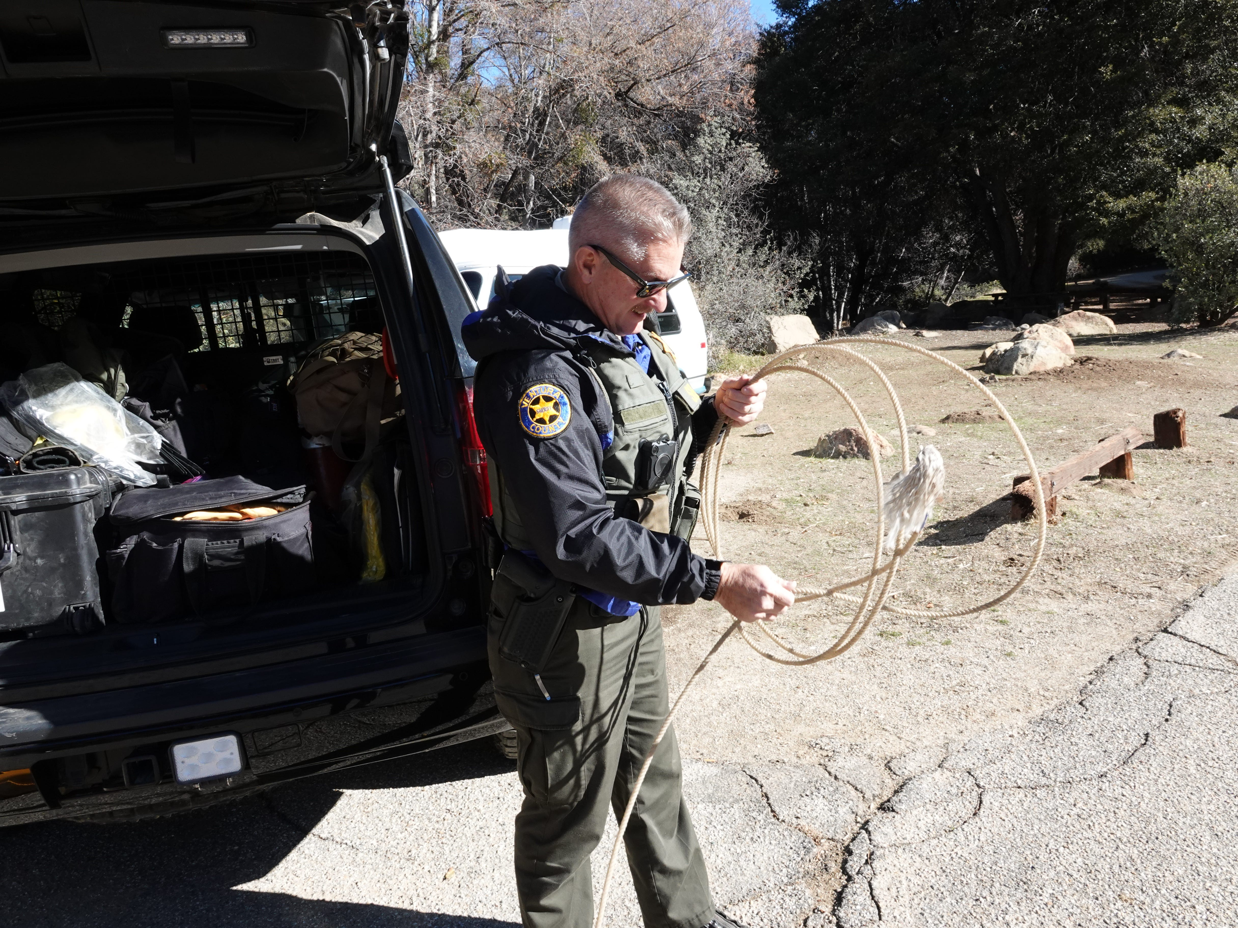 While looking for jumper cables to assist a stranded camper, Ventura County Deputy Bob Steele found a lasso in his patrol car Dec. 29. Steele is one of two deputies who patrol a 610-square mile area from the remote Lockwood Valley substation.