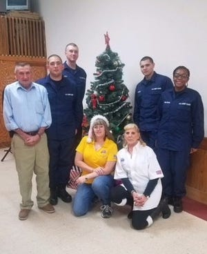 Members of Millville Elks Lodge #580 (front row, from left) Bill Meischke, district vice president, Vick Watson, member, and Arlene Hickman, Exalted Ruler, are joined by some U.S. Coast Guard recruits. The lodge members shared their holiday spirit by providing a home-cooked, Christmas dinner for the recruits.
