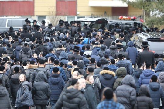 Students follow the casket of Kaser Mayor Bernard Rosenfeld during his funeral procession, Monday, Dec. 31, 2018.