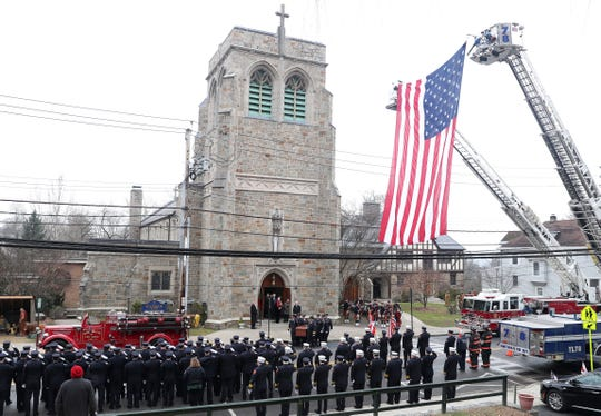 Firefighters line Grand Street in Croton-on-Hudson as the coffin of Deputy Chief Richard Nagle is carried out of Holy Name of Mary Church following his funeral Mass Dec. 31, 2018. Nagle, was also a former FDNY lieutenant, and chief of the Ridgefield, Connecticut, Fire Department. He died Dec. 27, 2018, at the age of 77.