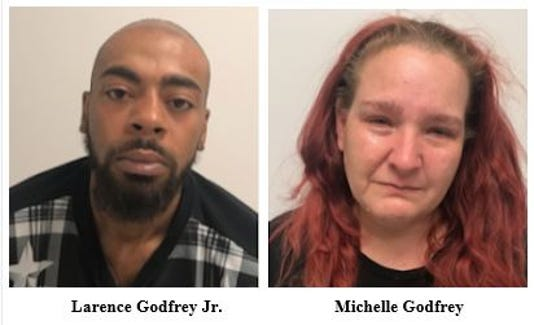 Larence and Michelle Godfrey arrested on warrants for