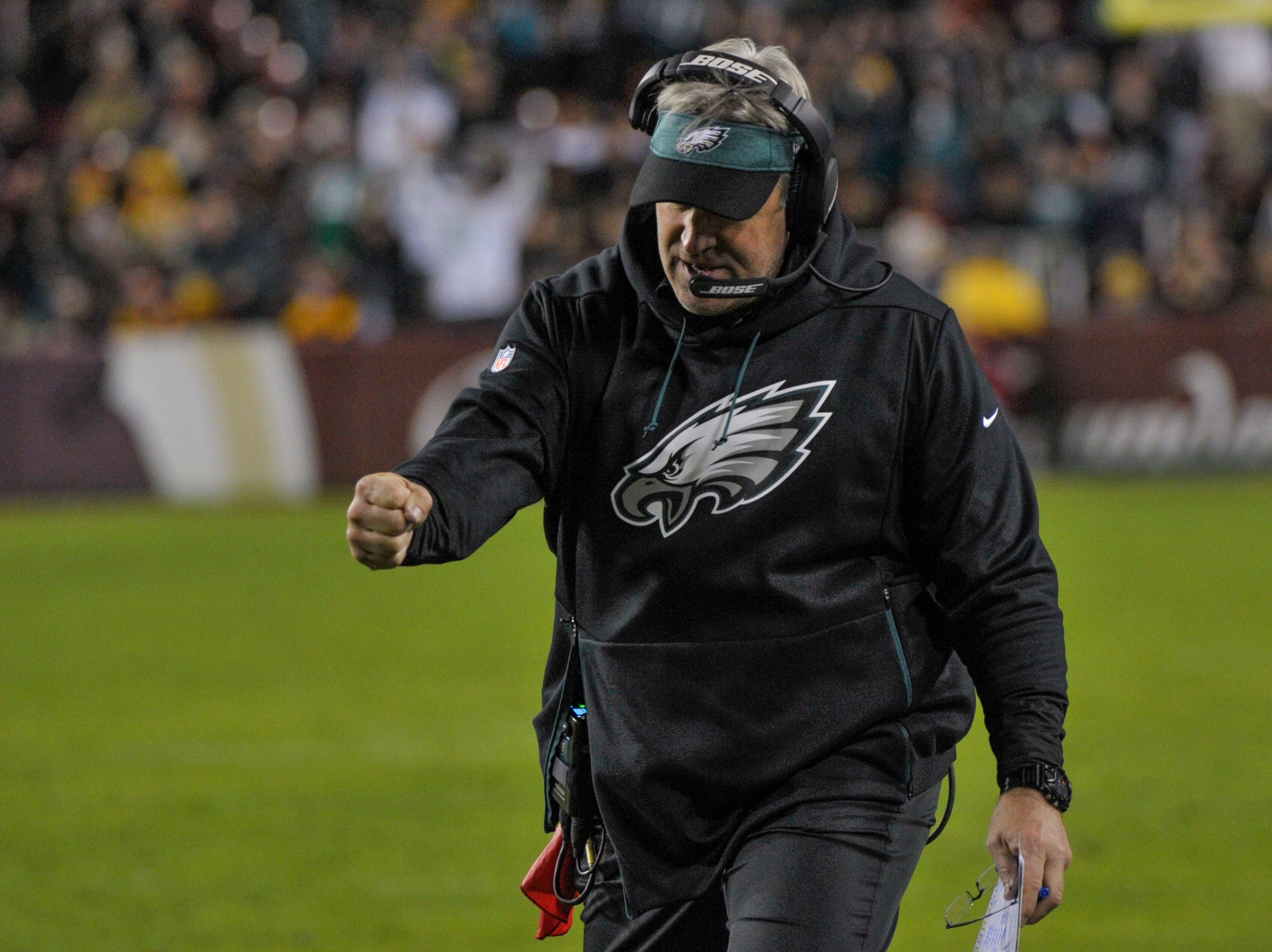 Philadelphia Eagles head coach Doug Pederson reacts to the offical confirmation of wide receiver Nelson Agholor's touchdown during the second half of the NFL football game against the Washington Redskins, Sunday, Dec. 30, 2018 in Landover, Md. (AP Photo/Mark Tenally)