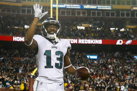 Philadelphia Eagles wide receiver Nelson Agholor (13) waves to the crowd after his touchdown during the second half of the NFL football game against the Washington Redskins, Sunday, Dec. 30, 2018 in Landover, Md. (AP Photo/Andrew Harnik)