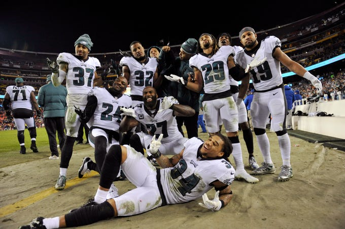 Members of the Philadelphia Eagles celebrate after the NFL football game between the Washington Redskins and the Philadelphia Eagles, Sunday, Dec. 30, 2018 in Landover, Md. The Eagles defeated the Redskins 24-0. (AP Photo/Mark Tenally)