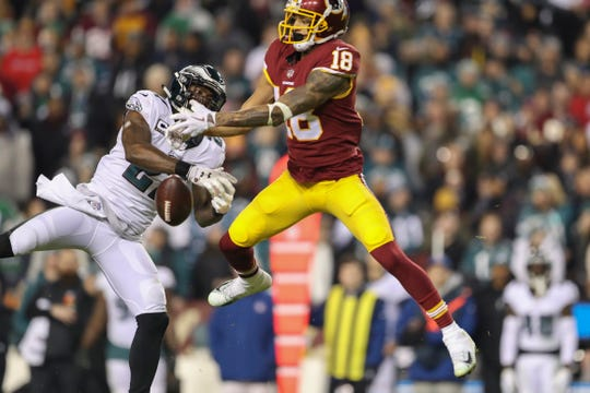 Philadelphia Eagles strong safety Malcolm Jenkins (27) breaks up a pass intended for Washington Redskins wide receiver Josh Doctson (18) during the second half of an NFL football game, Sunday, Dec. 30, 2018, in Landover, Md. (AP Photo/Andrew Harnik)