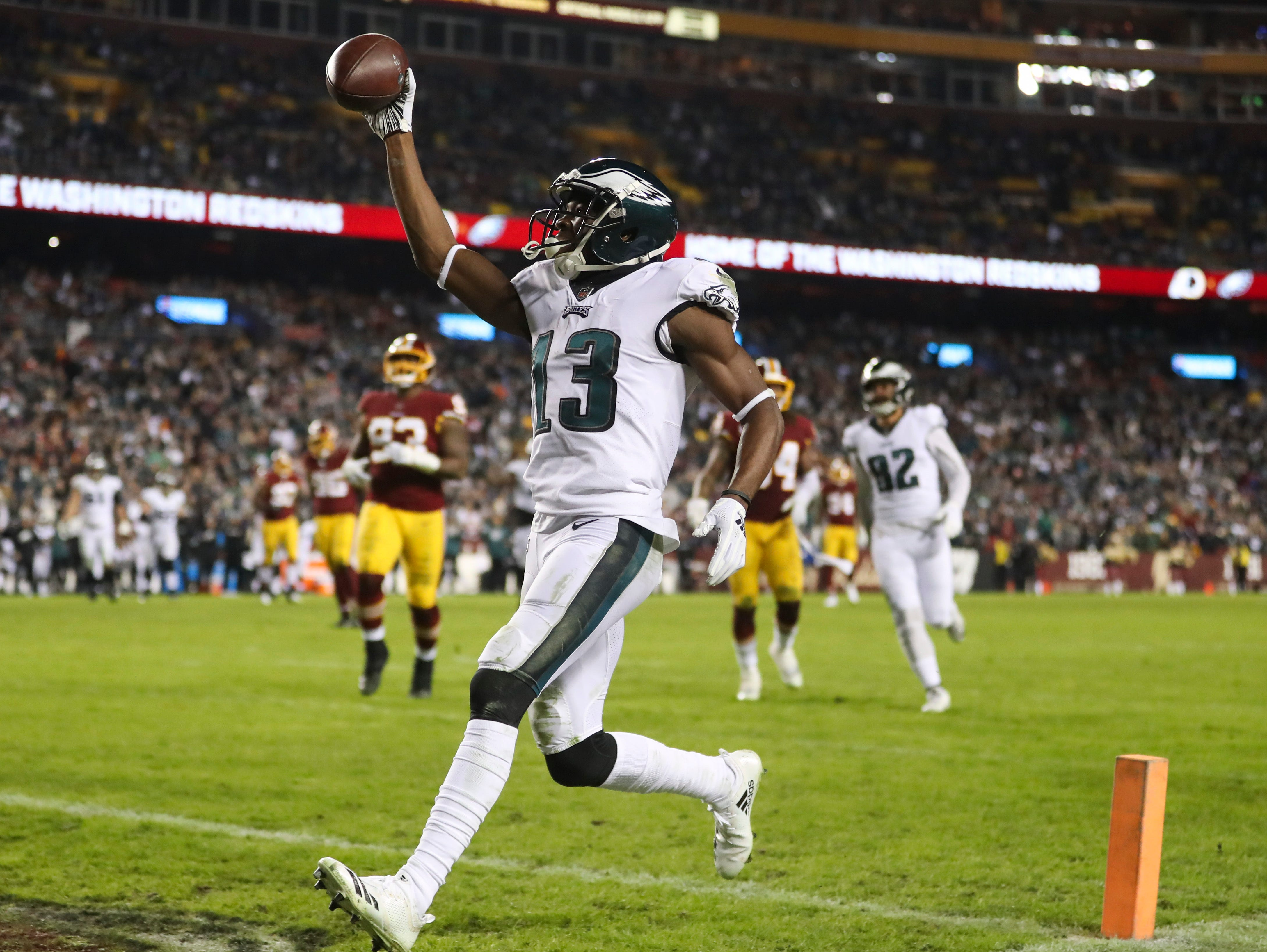 Philadelphia Eagles wide receiver Nelson Agholor (13) celebrates his touchdown during the second half of the NFL football game against the Washington Redskins, Sunday, Dec. 30, 2018, in Landover, Md. (AP Photo/Andrew Harnik)