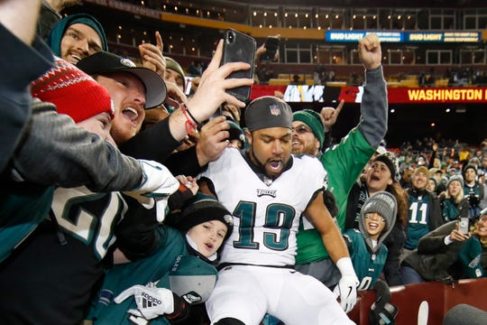 Philadelphia Eagles wide receiver Golden Tate (19) celebrates with fans after the NFL football game between the Washington Redskins and the Philadelphia Eagles, Sunday, Dec. 30, 2018 in Landover, Md. The Eagles defeated the Redskins 24-0. (AP Photo/Alex Brandon)