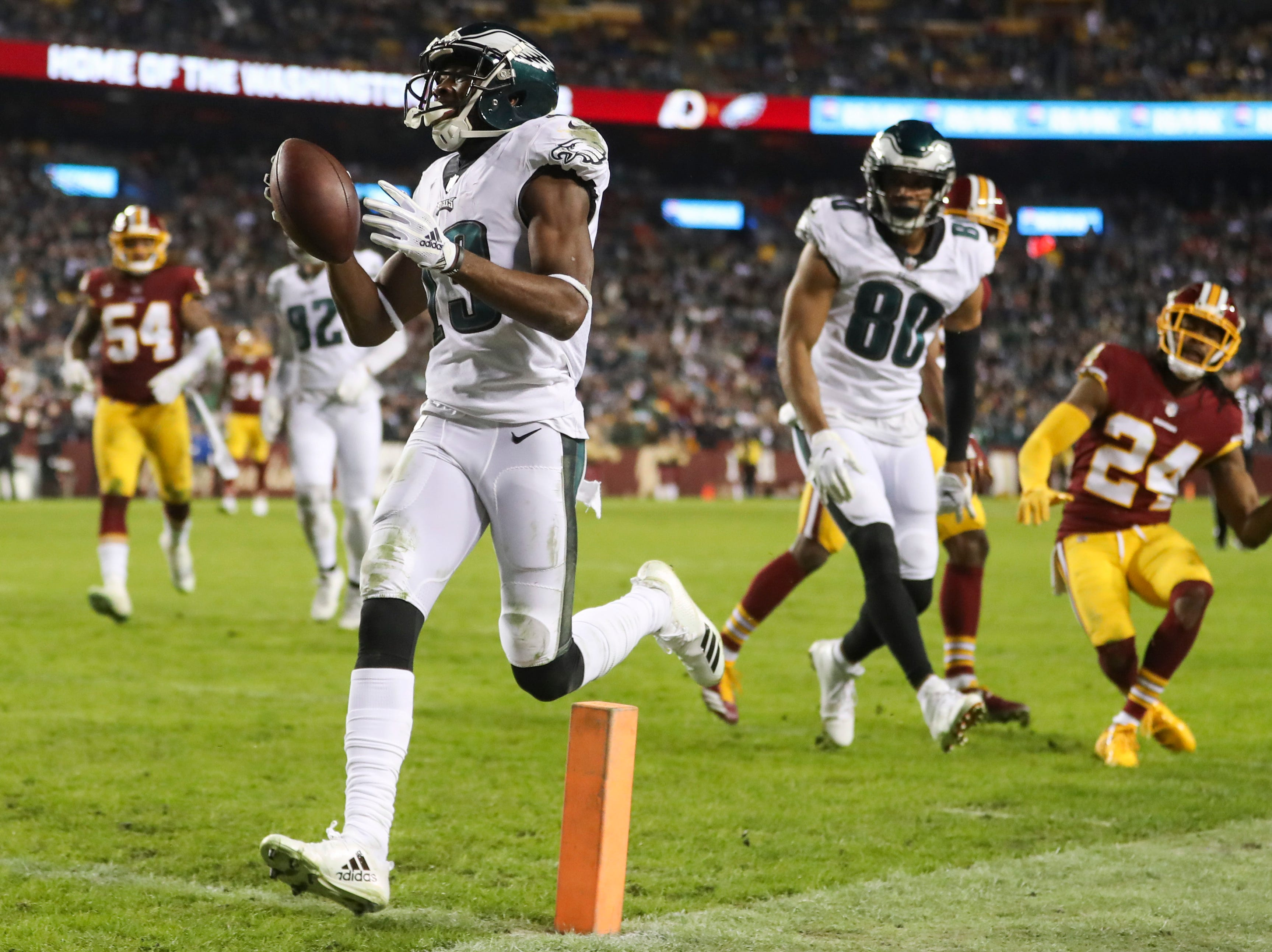 Philadelphia Eagles wide receiver Nelson Agholor (13) carries the ball into the end zone for a touchdown during the second half of the NFL football game against the Washington Redskins, Sunday, Dec. 30, 2018 in Landover, Md. (AP Photo/Andrew Harnik)