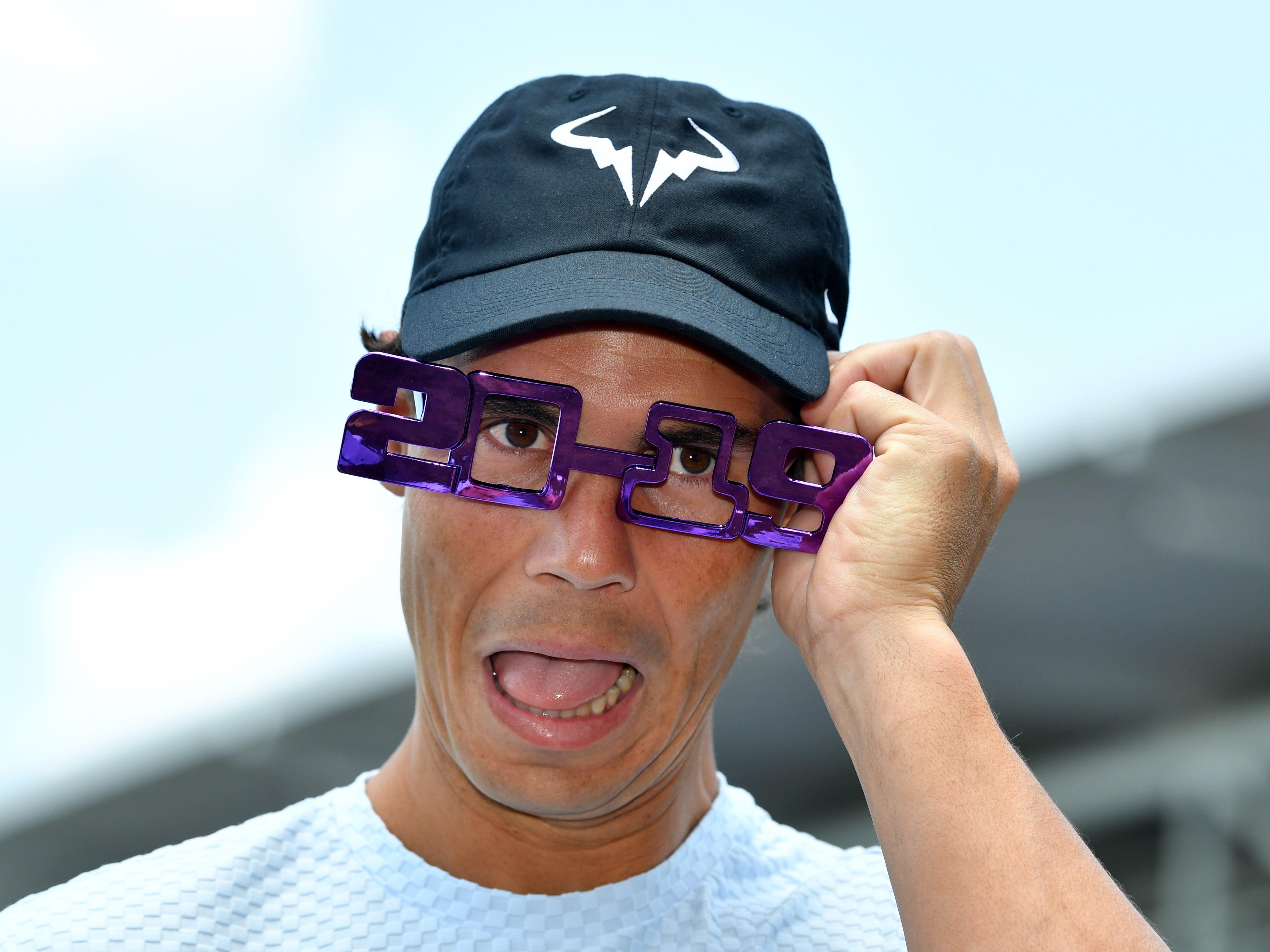 Rafael Nadal of Spain wears 2019 novelty glasses during day one of the Brisbane International tennis tournament in Brisbane, Australia.