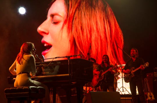 "Ally (Lady Gaga, at the piano) is a singer rocketing to fame in ""A Star Is Born."""