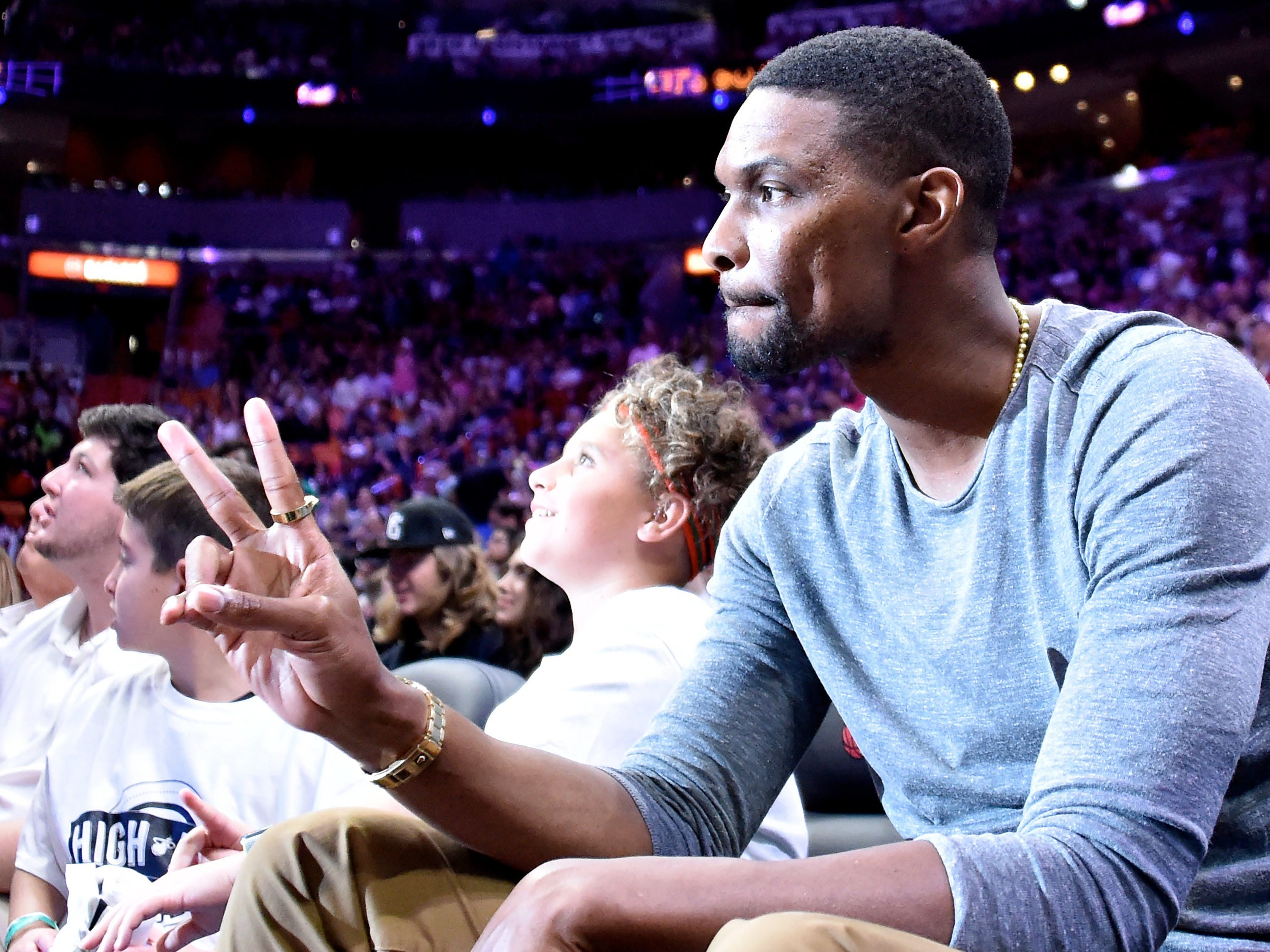 Dec. 30: Former Heat star and two-time champion Chris Bosh takes in a game against the Timberwolves in Miami.