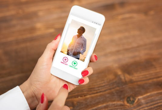 Woman Using Dating App And Swiping User Photos