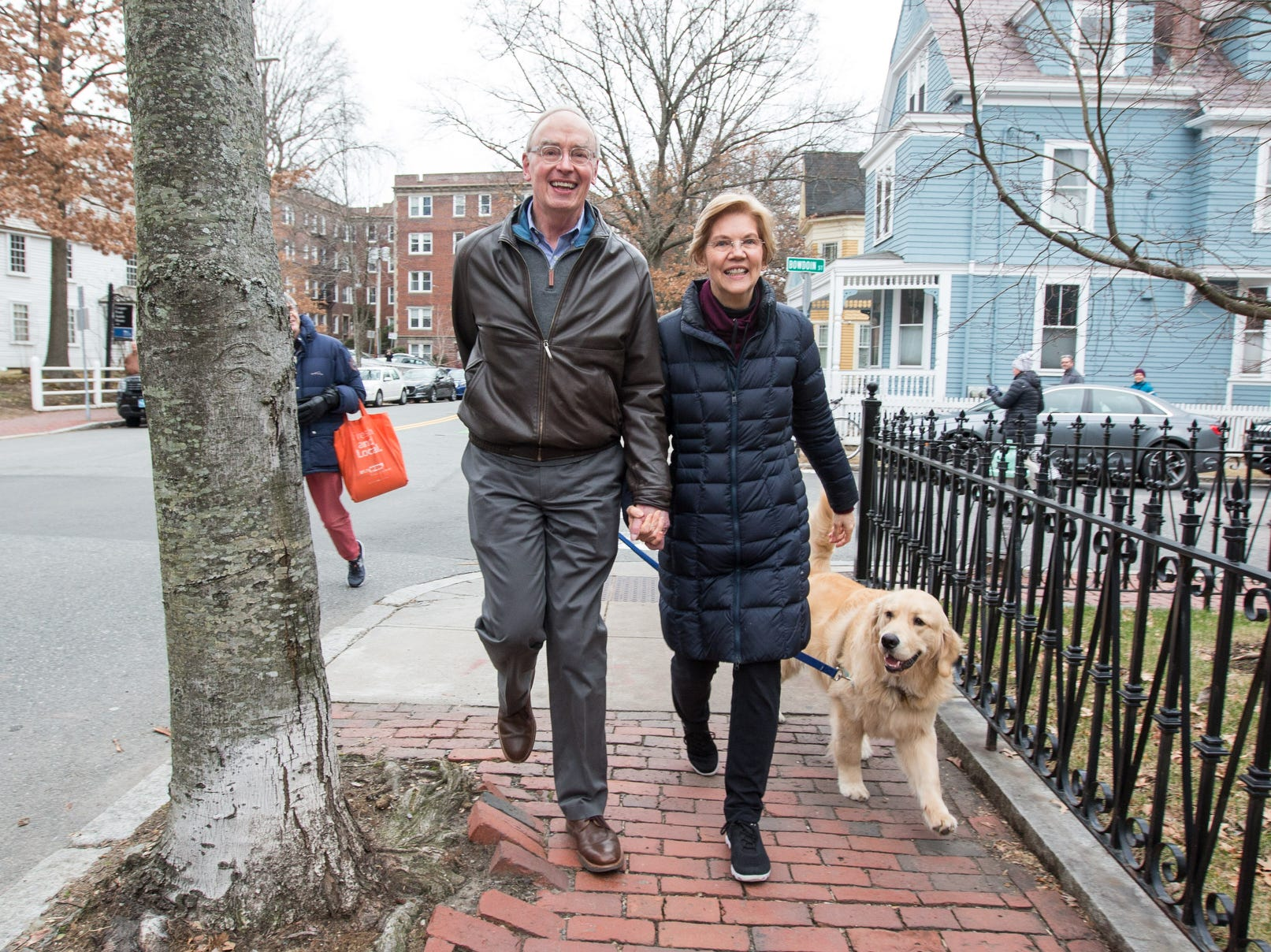 Sen. Elizabeth Warren (D-MA), her husband Bruce Mann and their dog Bailey walk back to their home after Warren addressed the media following her announcement that she formed an exploratory committee for a 2020 Presidential run.