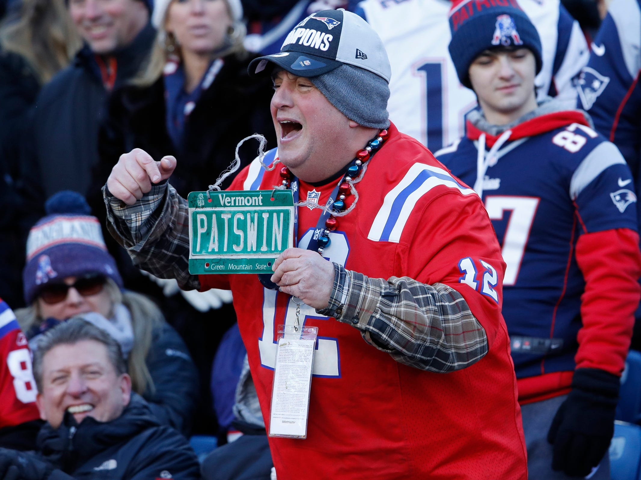 A New England Patriots fan cheers as the Patriots take on the New York Jets in the first half at Gillette Stadium.