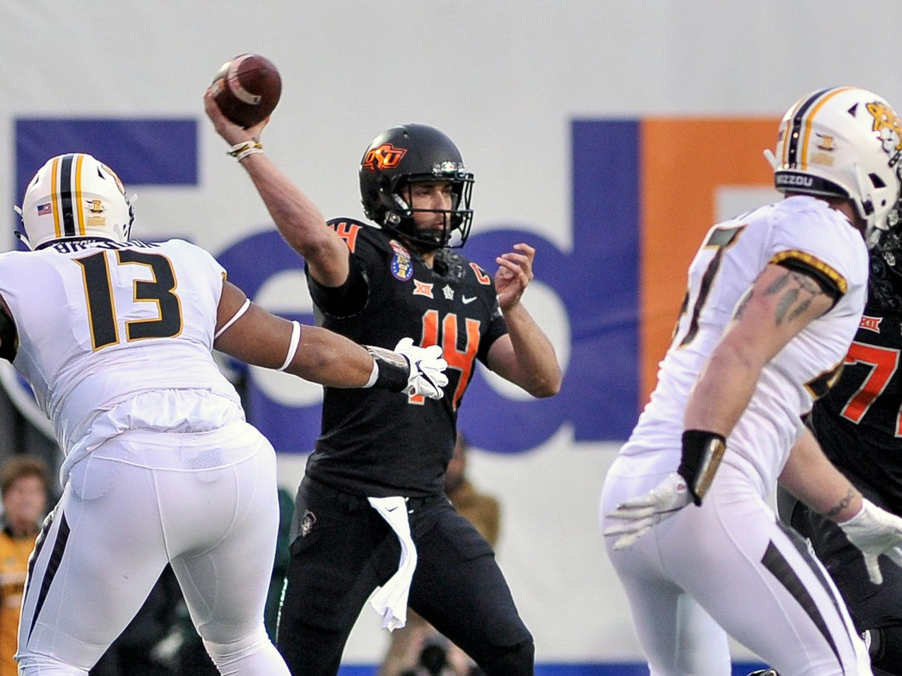 Oklahoma State quarterback Taylor Cornelius looks to throw against the Missouri defense during the first half of the 2018 Liberty Bowl.