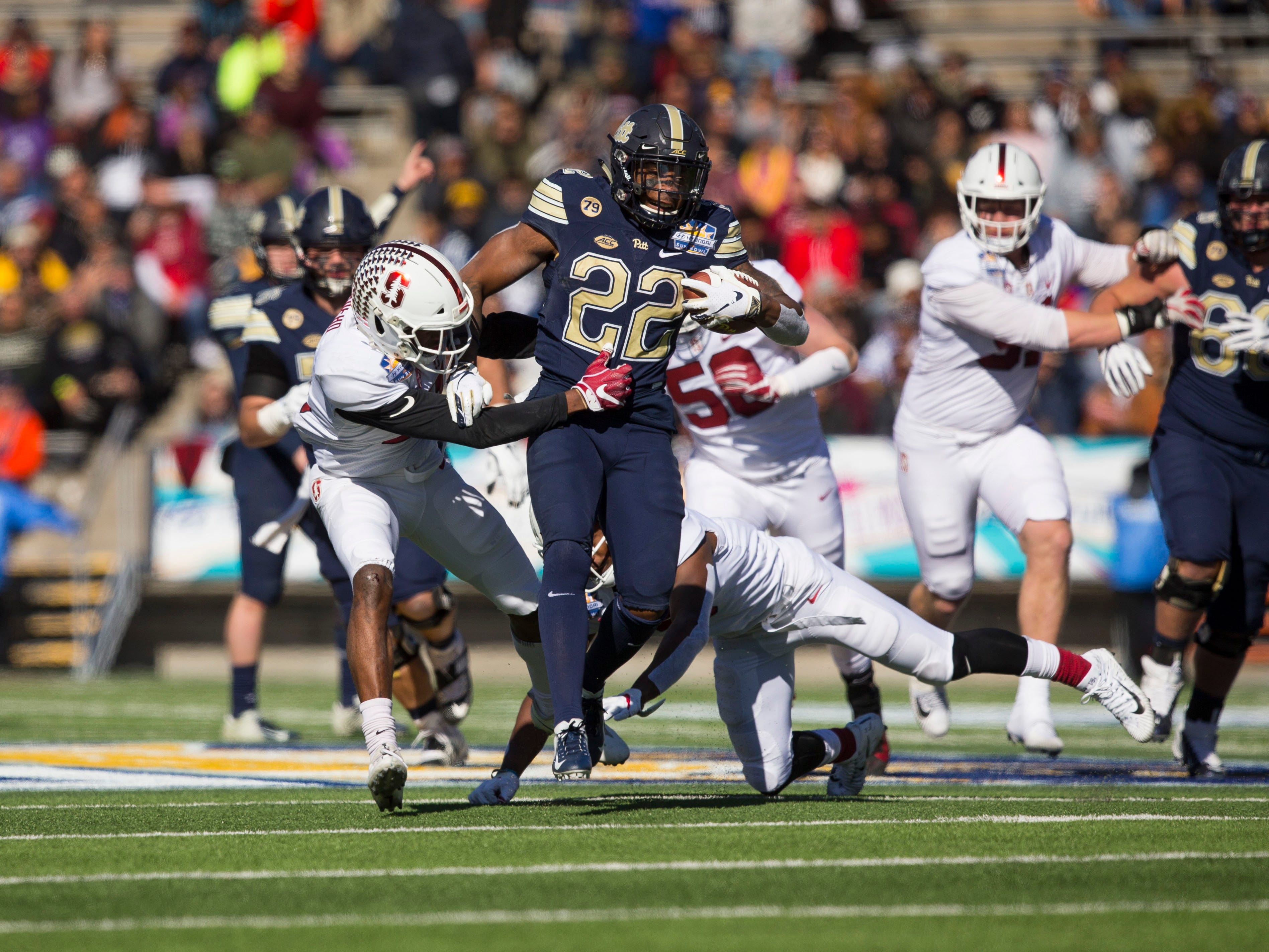 Pittsburgh running back Darrin Hall carries the ball against Stanford during the first half of the 2018 Sun Bowl.