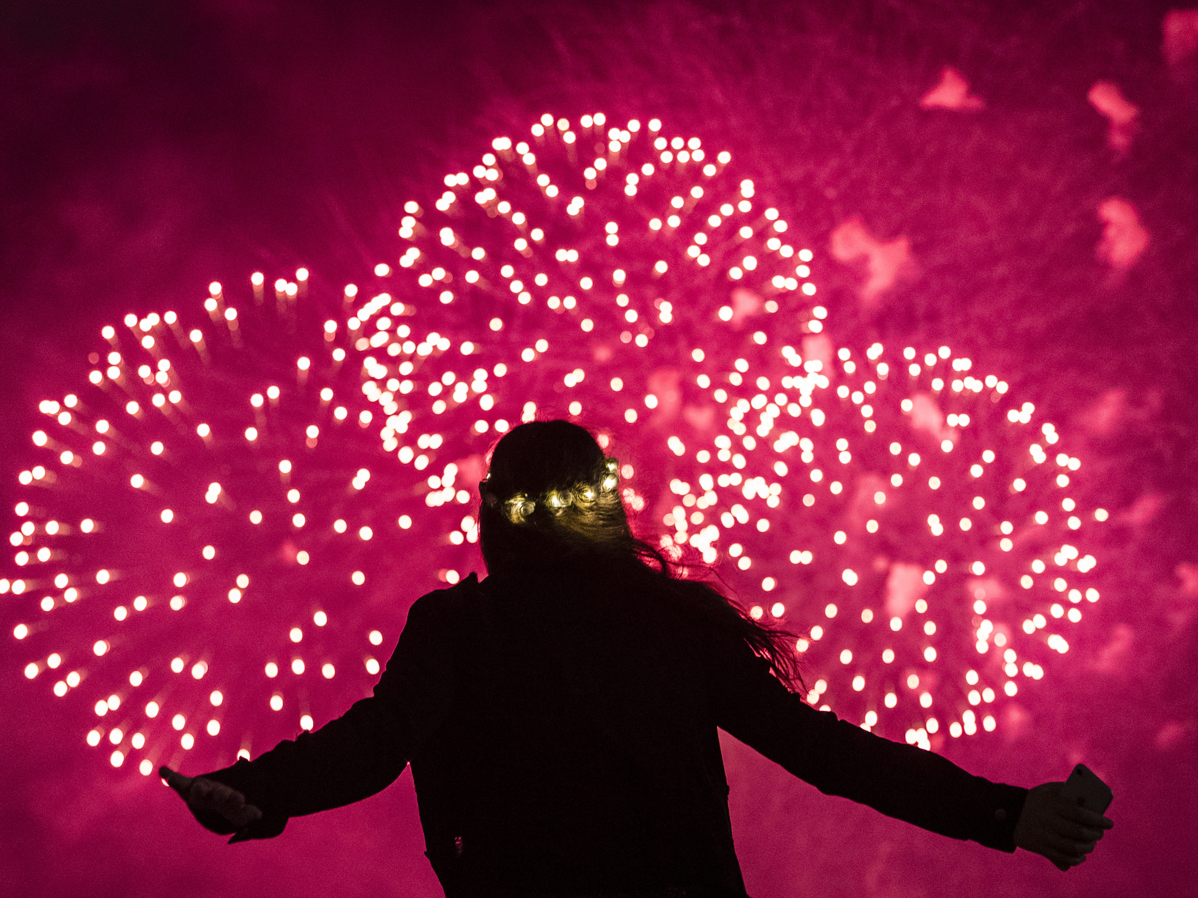 A young girl watches the fireworks over Sydney Harbour in Sydney, Australia.