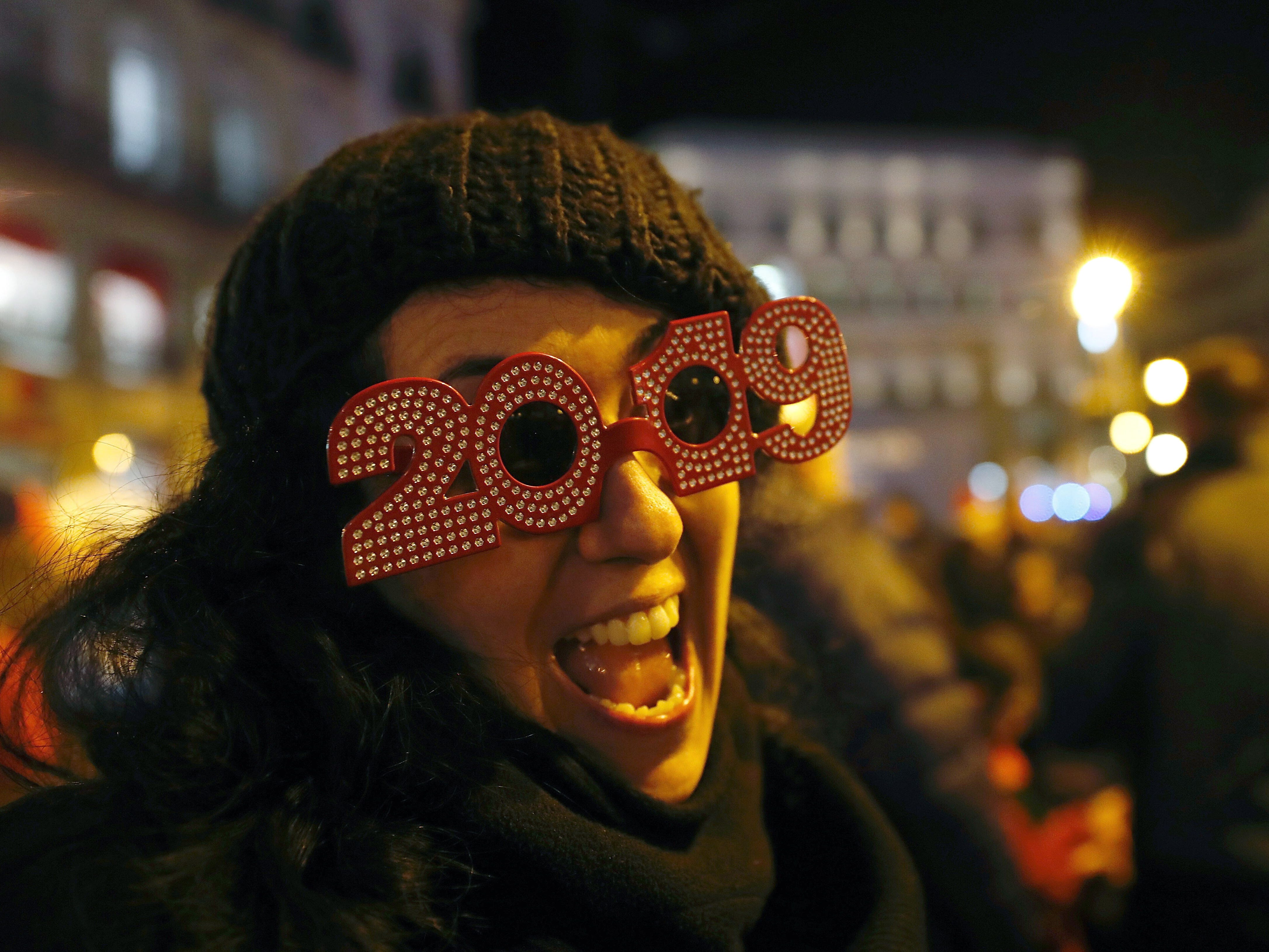 People gather at Puerto del Sol to celebrate in advance the New Year's Eve while as a clock has its final inspection twenty-four hours before the bells ring twelve times to commemorate the new year in Madrid, Spain.