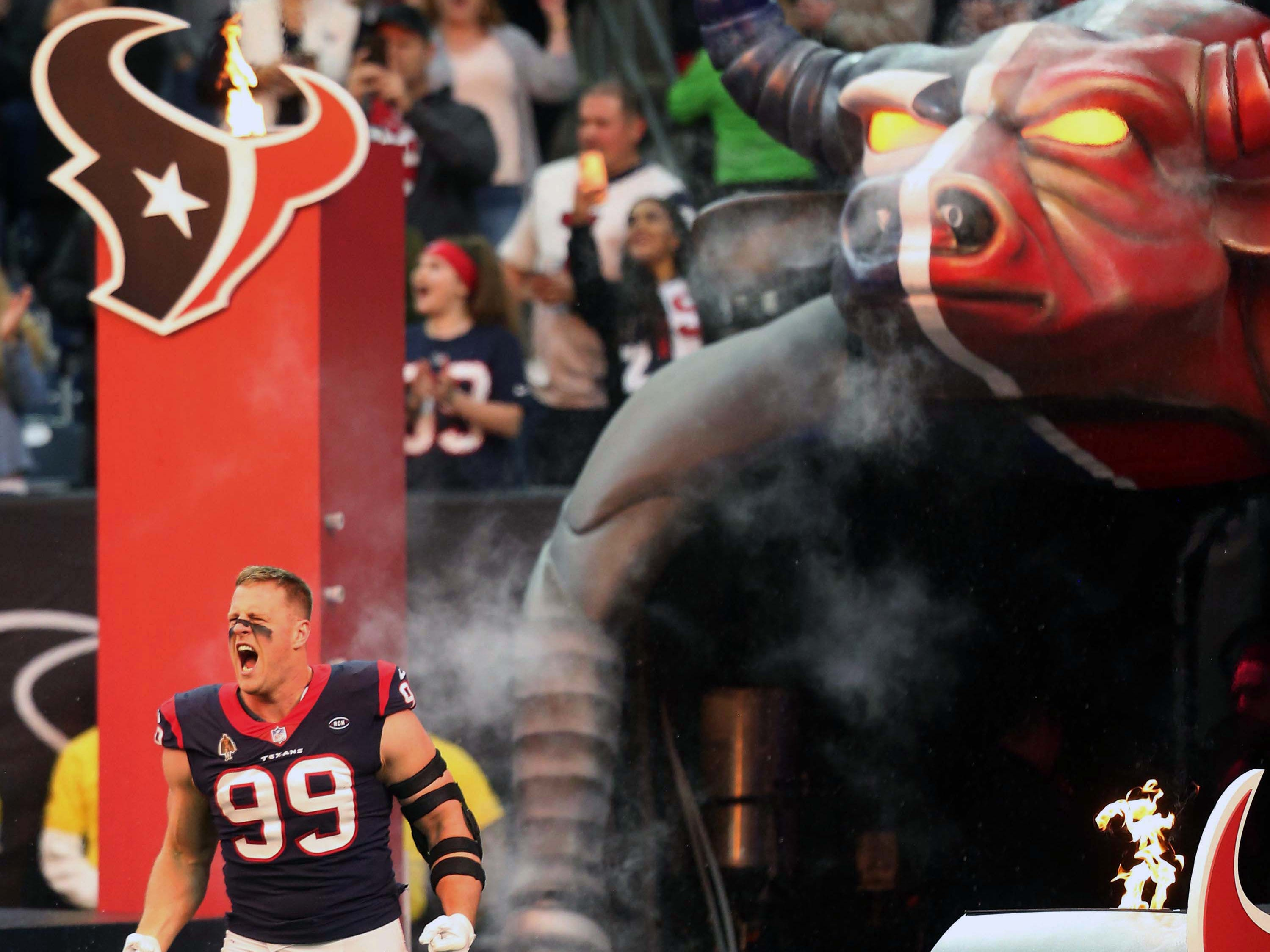 Houston Texans defensive end J.J. Watt is introduced before playing against the Jacksonville Jaguars at NRG Stadium.
