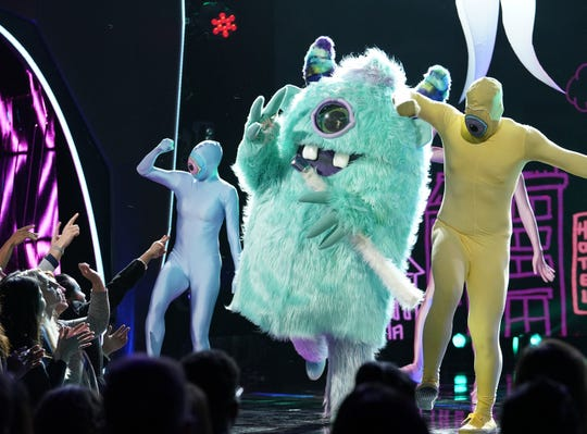 "Monster sings in ""The Masked Singer."""