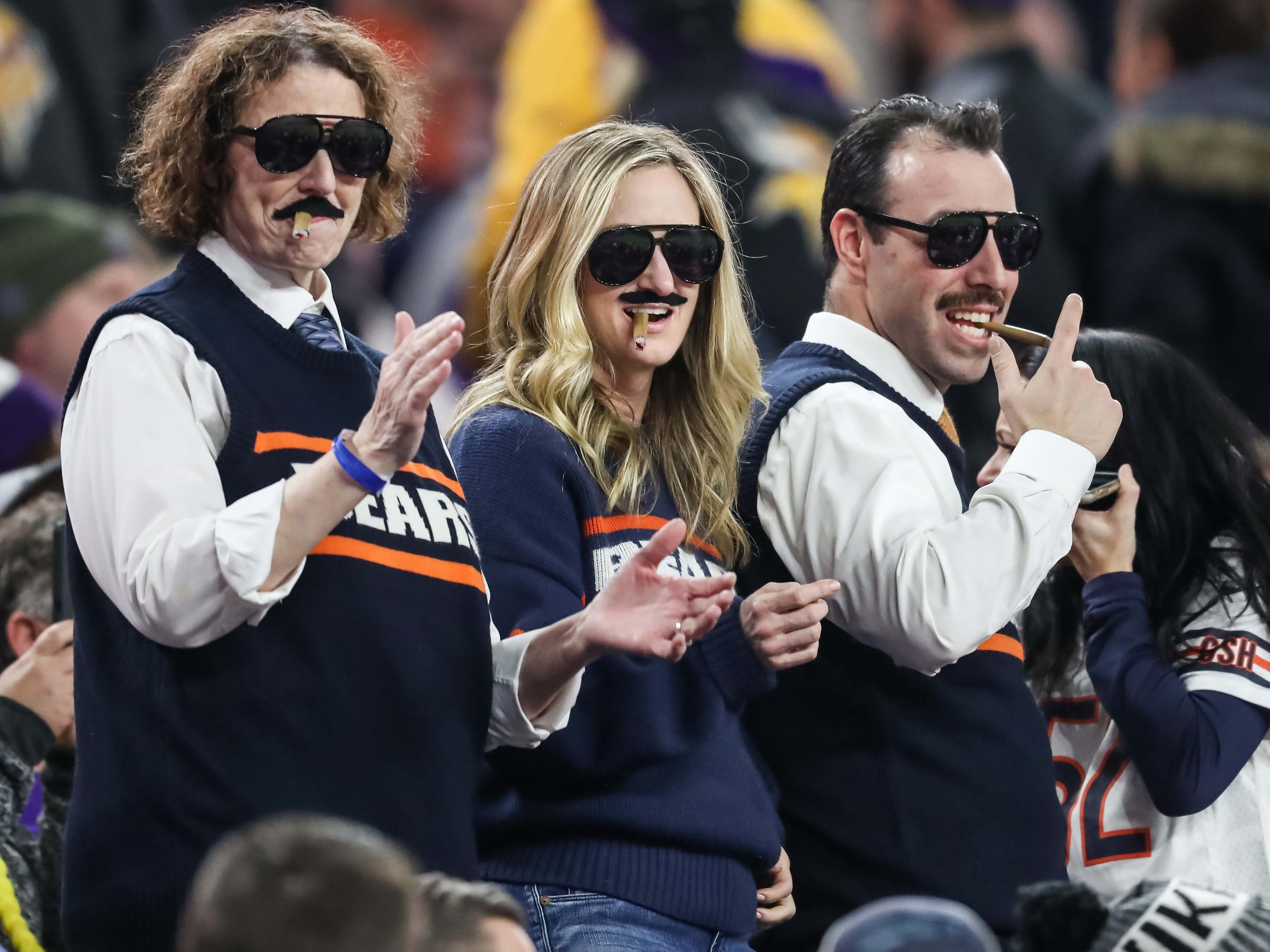 Chicago Bears fans celebrate during the fourth quarter against the Minnesota Vikings at U.S. Bank Stadium.