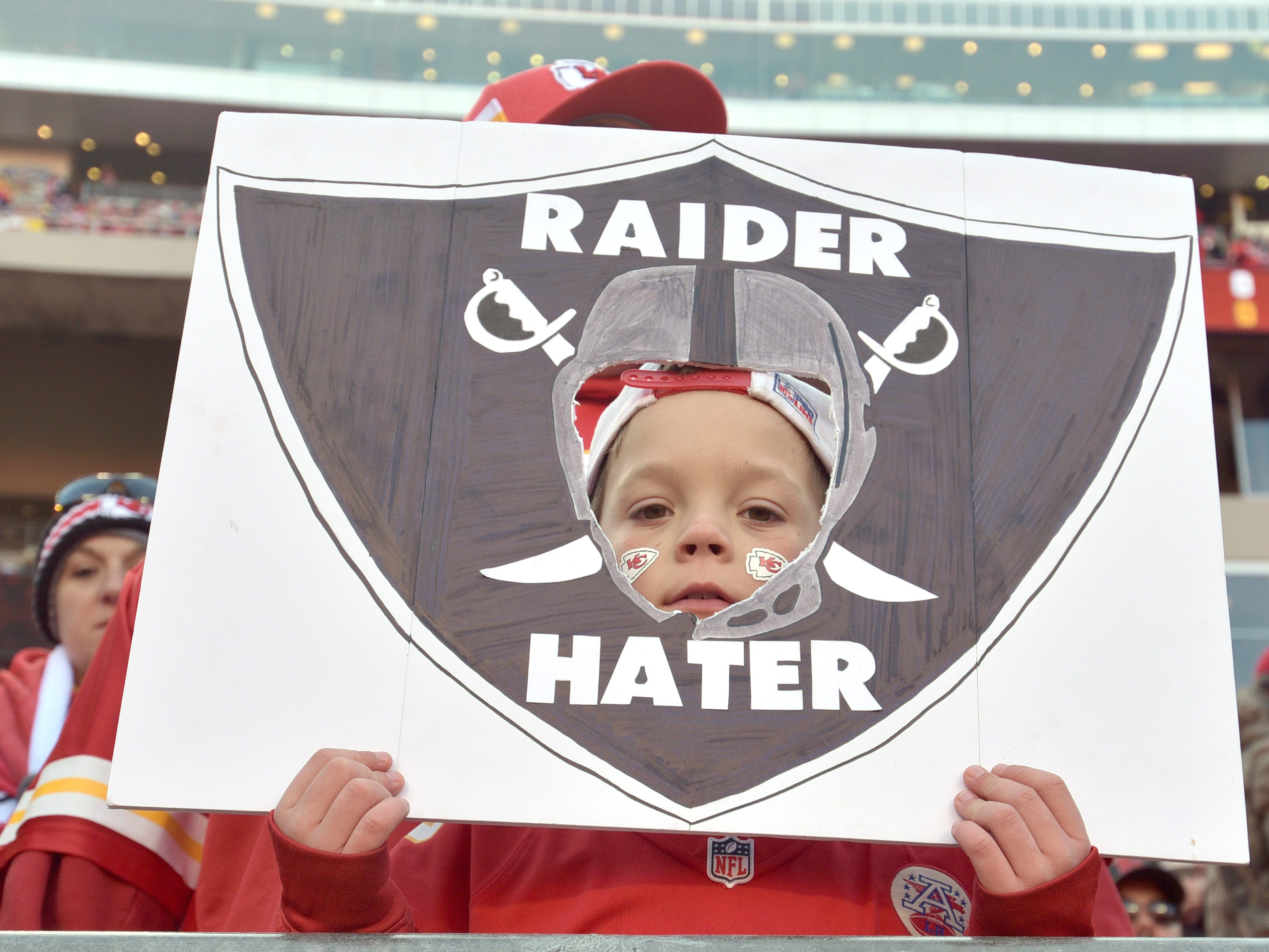 A young Kansas City Chiefs fan shows his support before a game against the Oakland Raiders at Arrowhead Stadium.