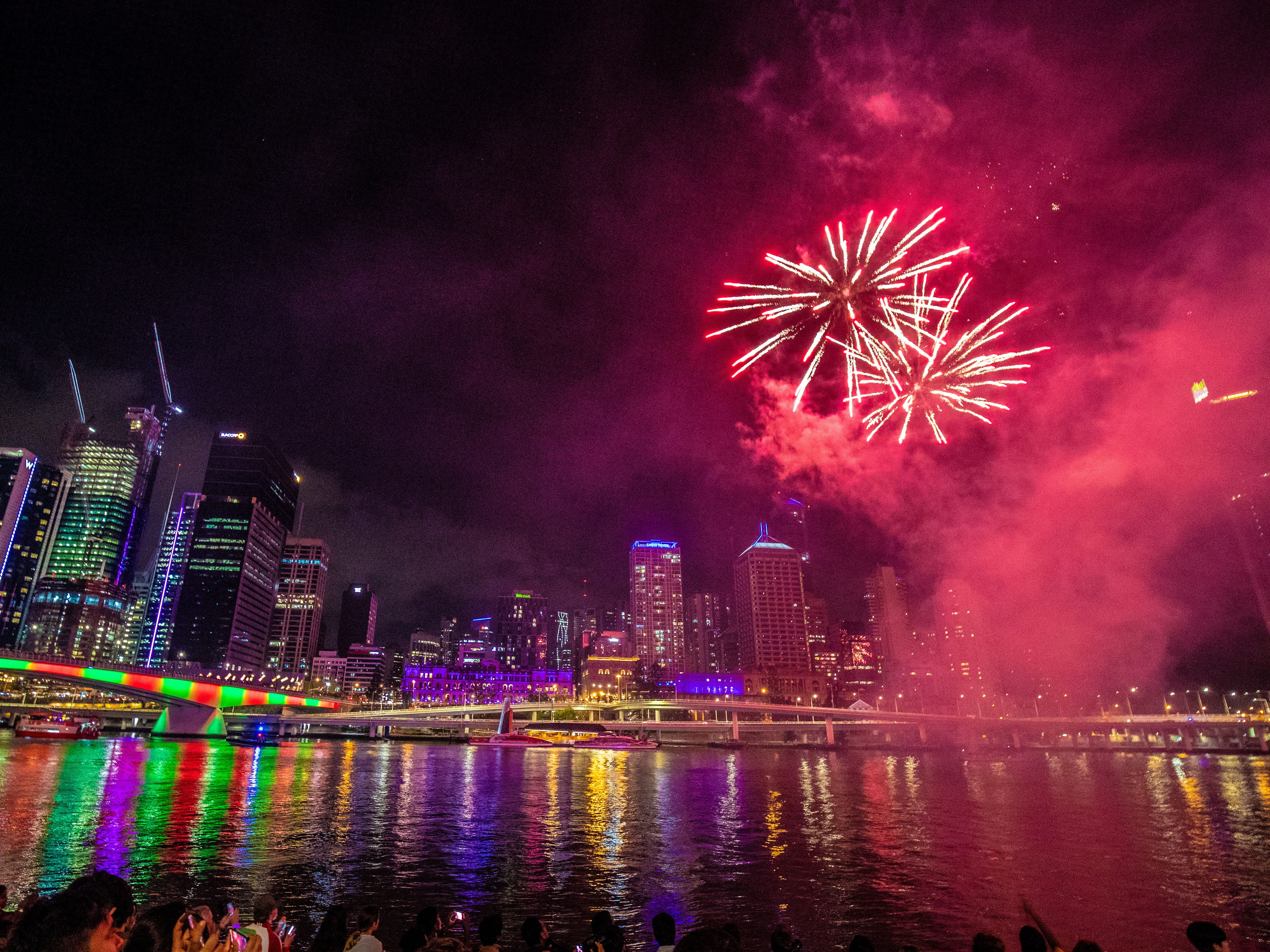 People watch early fireworks ahead of New Year's Eve over the Brisbane River at Southbank in Brisbane, Queensland, Australia.