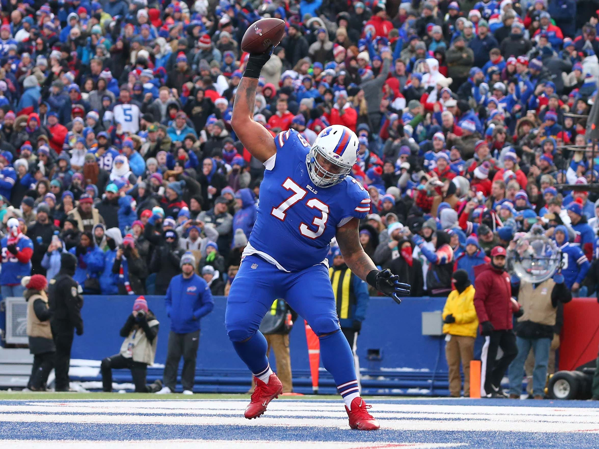 Buffalo Bills offensive tackle Dion Dawkins spikes the ball after a touchdown run by running back LeSean McCoy against the Miami Dolphins during the third quarter at New Era Field.