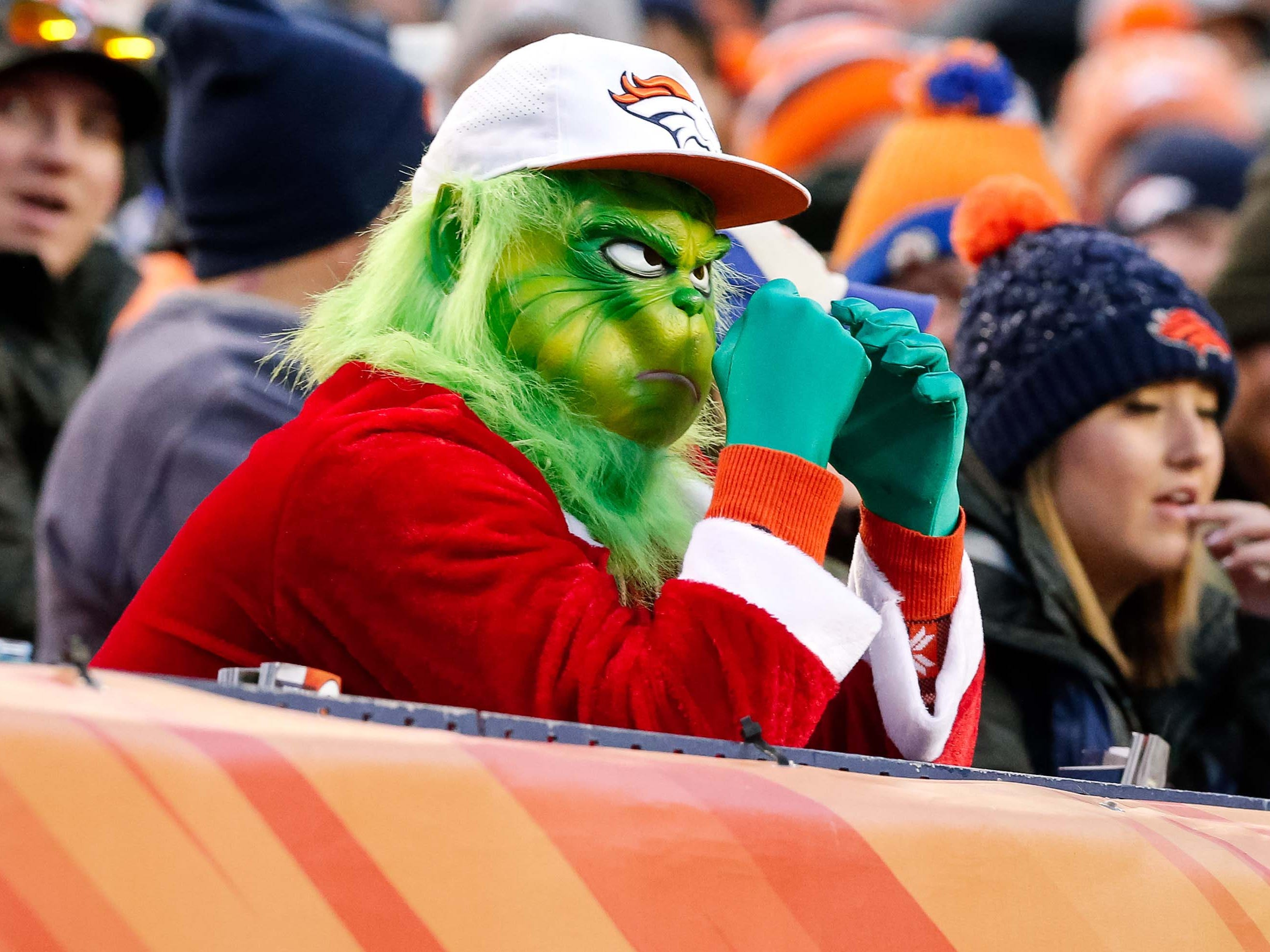 A Denver Broncos fan looks on in the third quarter against the Los Angeles Chargers at Broncos Stadium at Mile High.