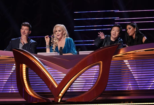 "Panelists Robin Thicke, Jenny McCarthy, Ken Jeong and Nicole Scherzinger on ""The Masked Singer."""