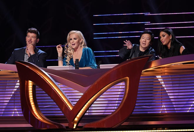 """Panelists Robin Thicke, Jenny McCarthy, Ken Jeong and Nicole Scherzinger on """"The Masked Singer."""""""