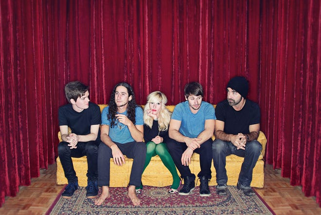 Members of the musical group Walk Off the Earth: Joel Cassady, left, Gianni Luminati, Sarah Blackwood, Ryan Marshall and Mike Taylor.