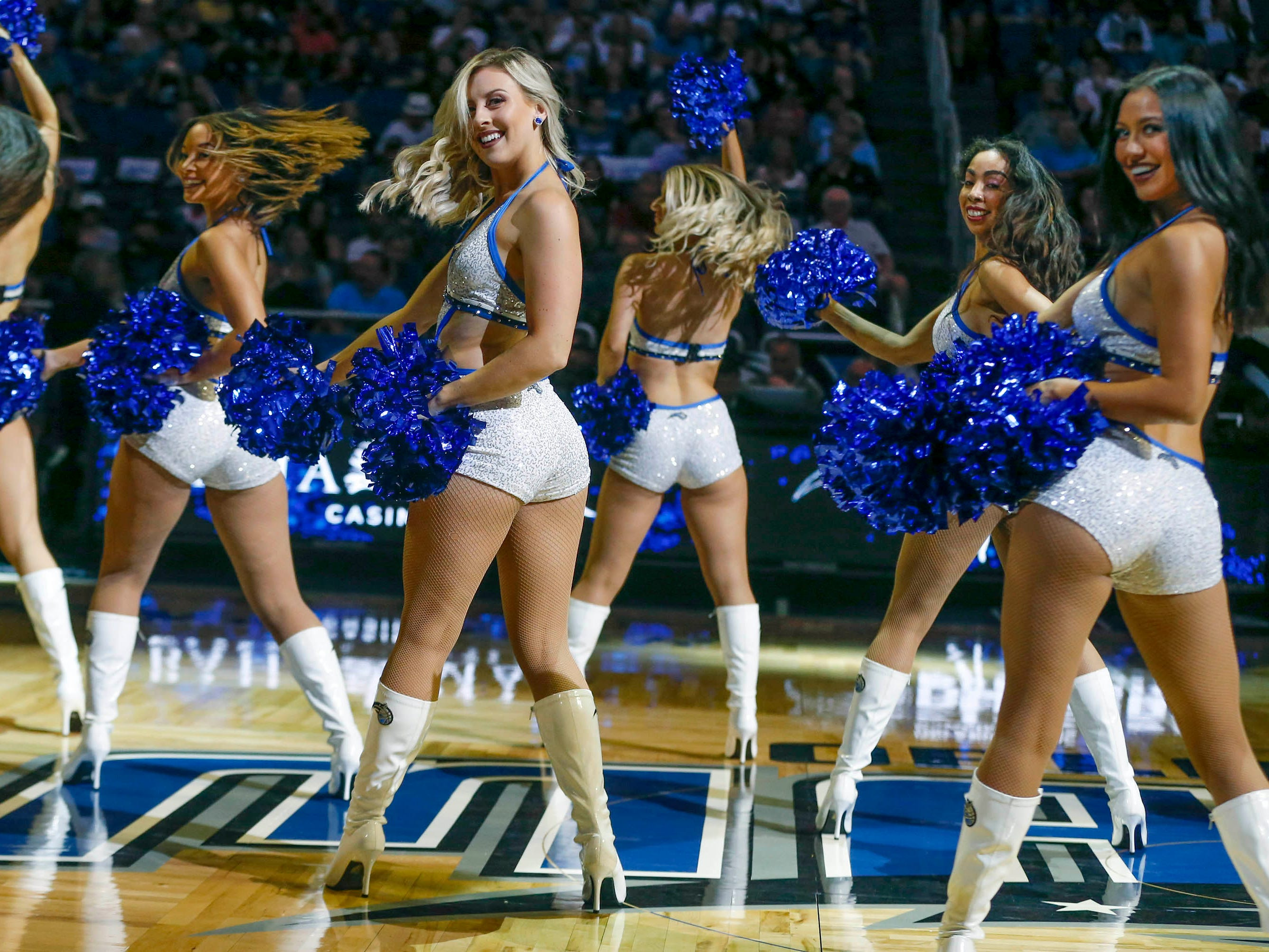 Dec. 30: Magic dancers entertain the crowd during a stop in play against the Pistons in Orlando.