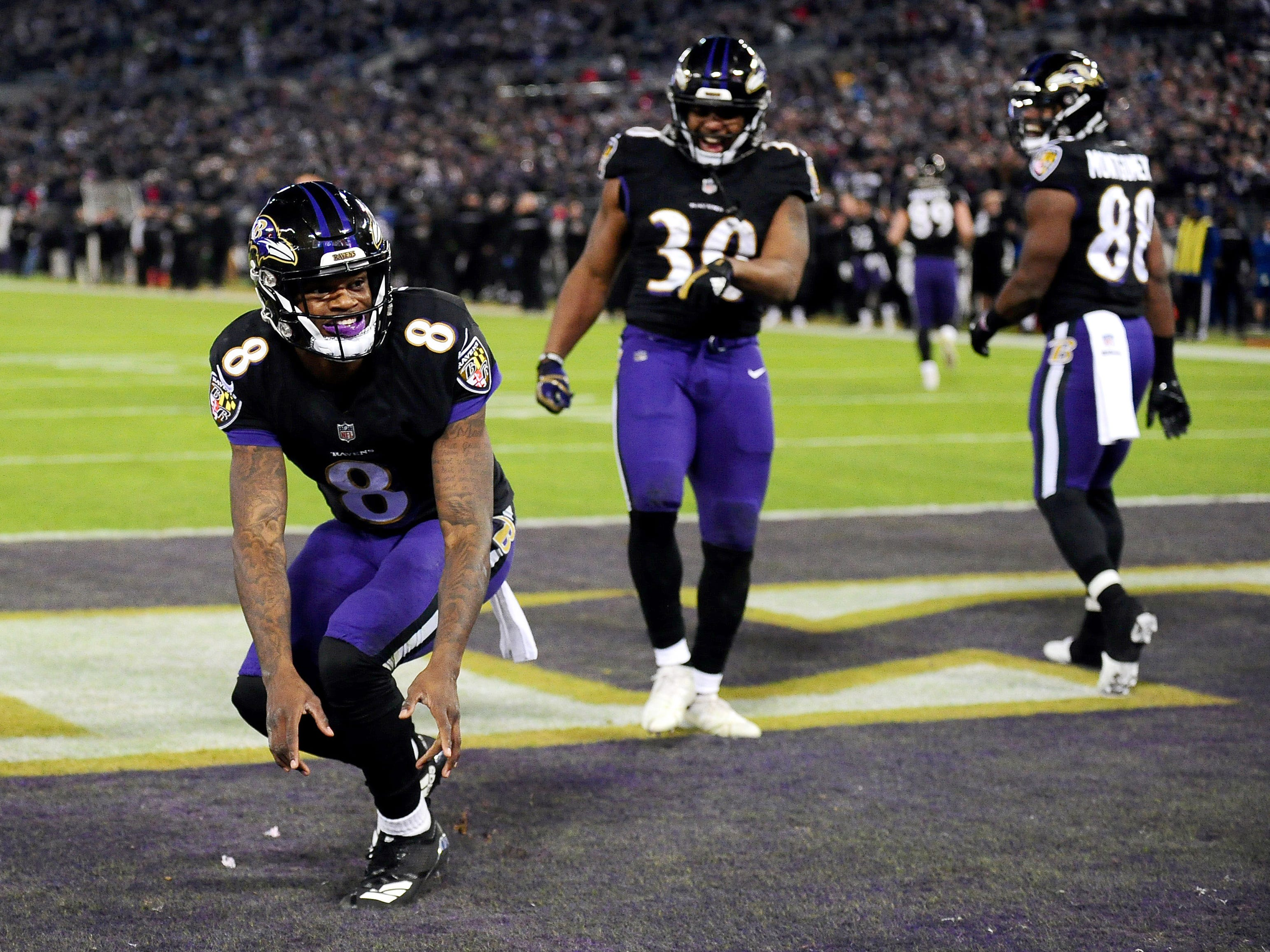Baltimore Ravens quarterback Lamar Jackson celebrates after scoring a touchdown in the second quarter against the Cleveland Browns at M&T Bank Stadium.
