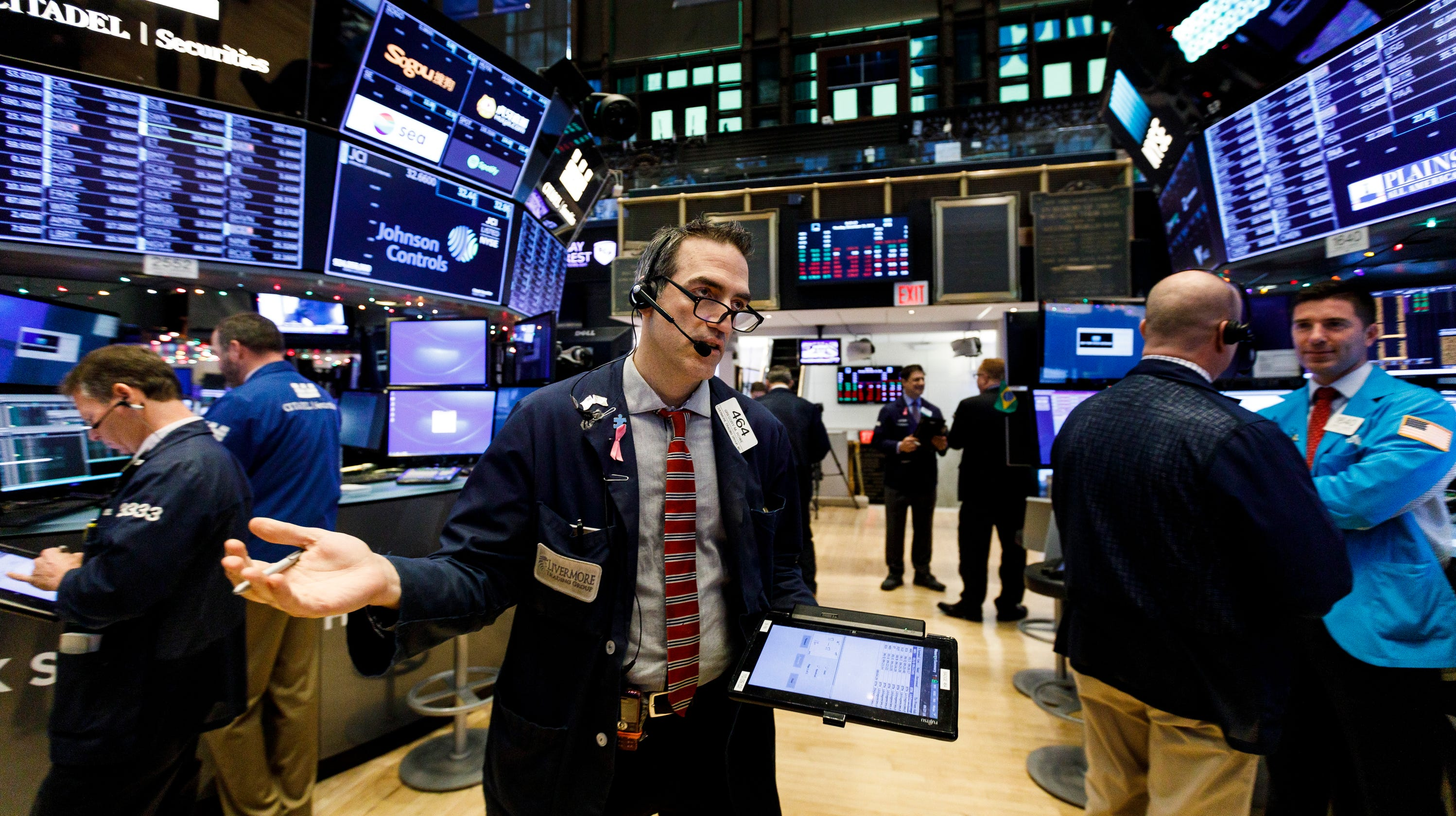 Dow rises on New Year's Eve as stock market ends losing year on a high