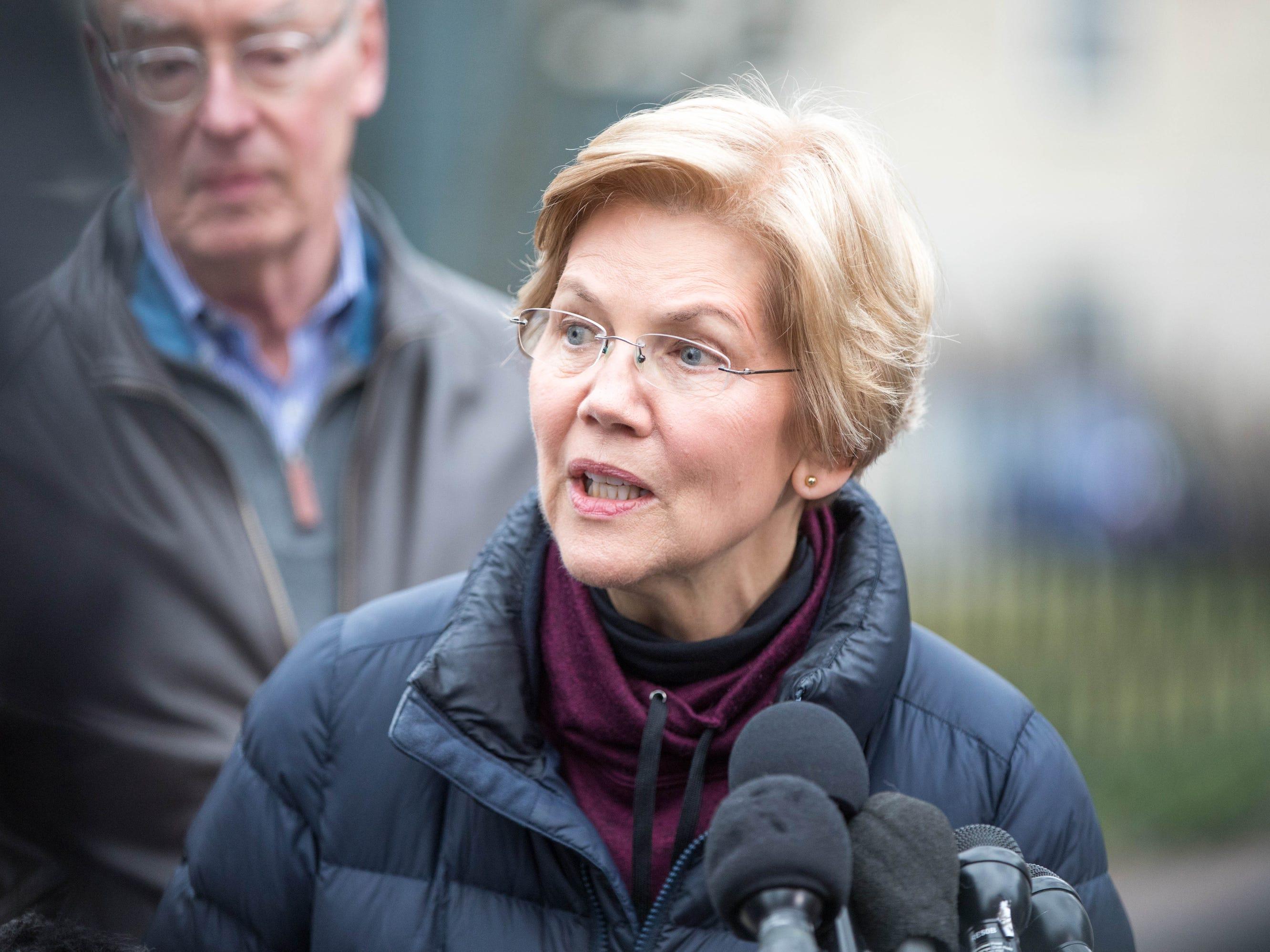 Sen. Elizabeth Warren (D-MA), addresses the media outside of her home after announcing she formed an exploratory committee for a 2020 Presidential run on Dece. 31, 2018 in Cambridge, Mass.