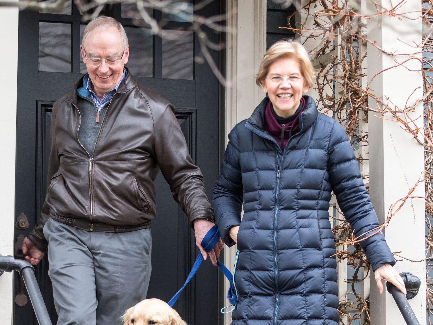 Sen. Elizabeth Warren (D-MA), leaves her home with her husband Bruce Mann and dog Bailey to address the media after announcing a potential Presidential run for 2020.