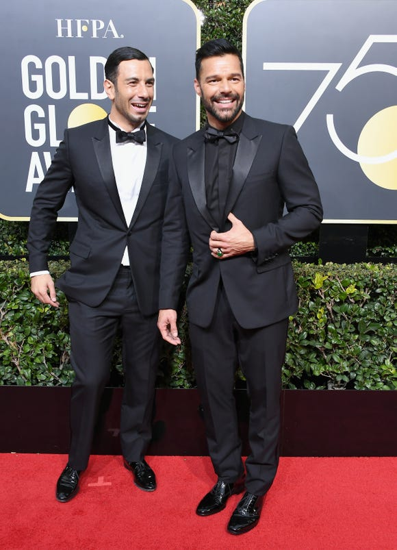 Ricky Martin (R) and Jwan Yosef (L) have a full house.