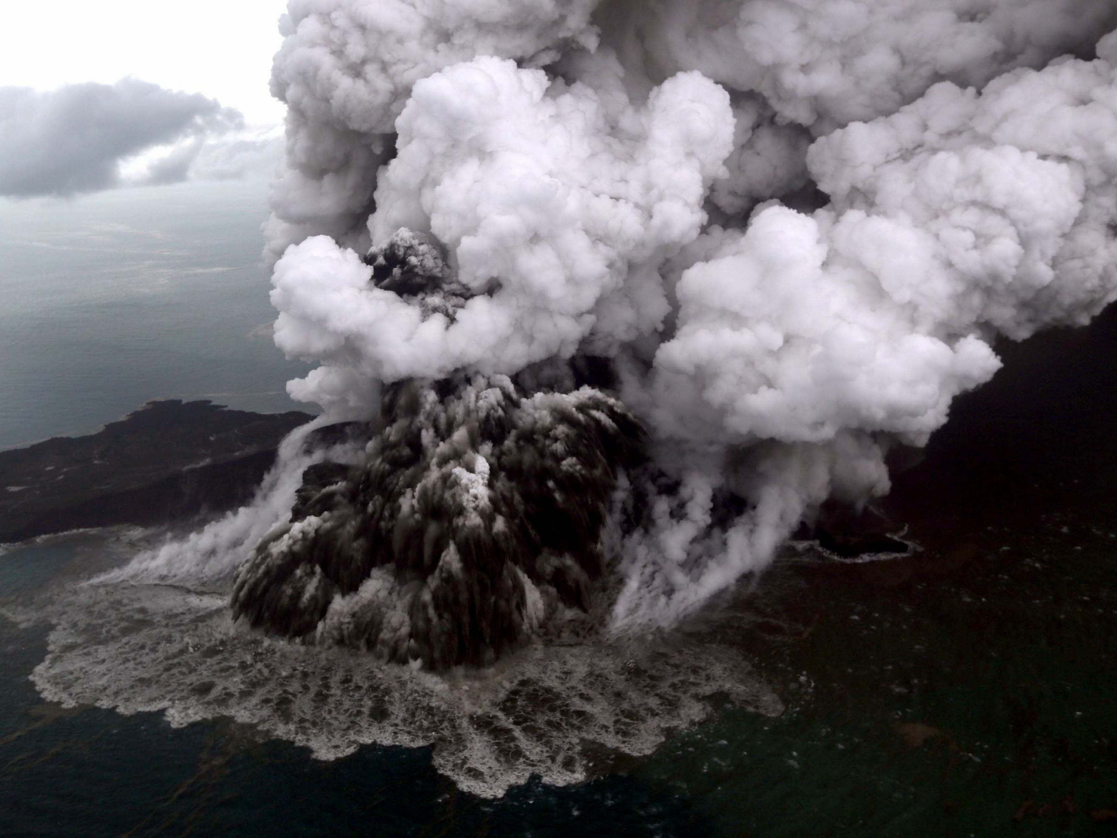 This aerial picture taken on Dec. 23, 2018 by Bisnis Indonesia shows the Anak (Child) Krakatoa volcano erupting in the Sunda Straits off the coast of southern Sumatra and the western tip of Java.  The death toll from the Dec. 22 volcano-triggered tsunami in Indonesia has risen to 281, with more than 1,000 people injured, the national disaster agency said on Dec. 24, as the desperate search for survivors ramped up.