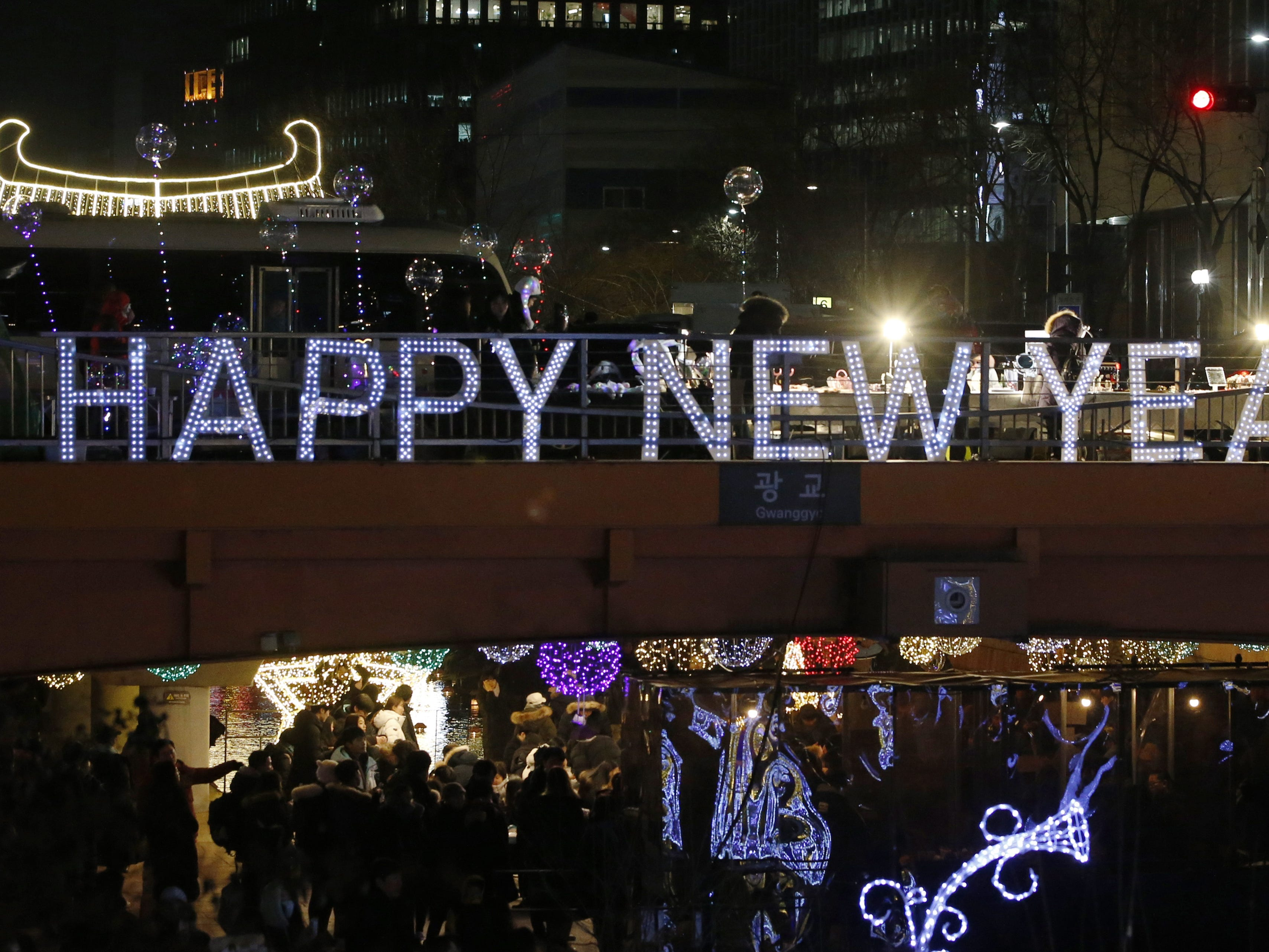 People walk among decorations in Seoul, South Korea.