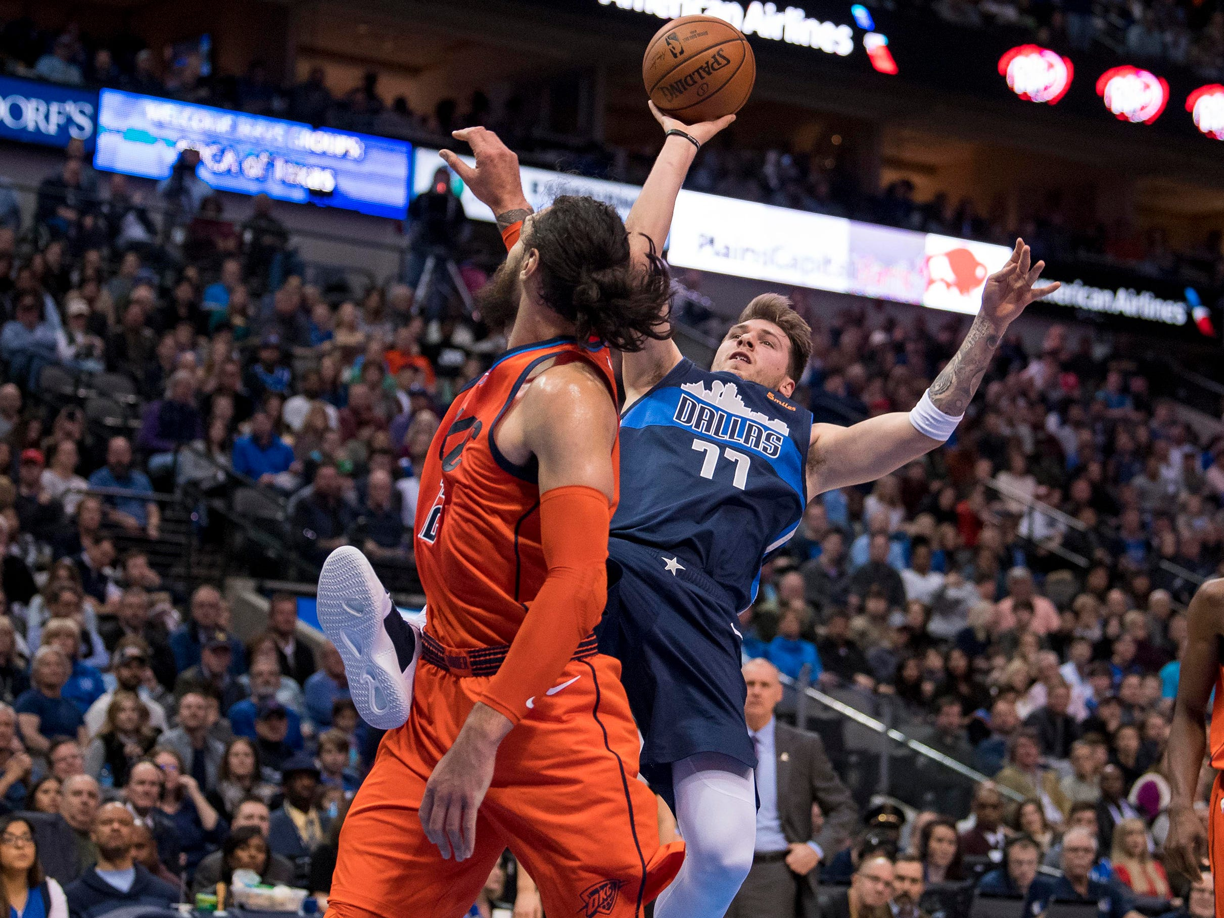 Dec. 30: Mavericks forward Luka Doncic (77) takes the bump and puts up a wild shot over Thunder defender Steven Adams (12) during the first half in Dallas.